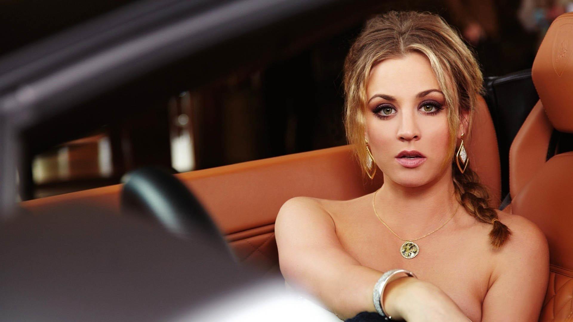 Kaley Cuoco-Sweeting posing in a Lamborghini wallpaper