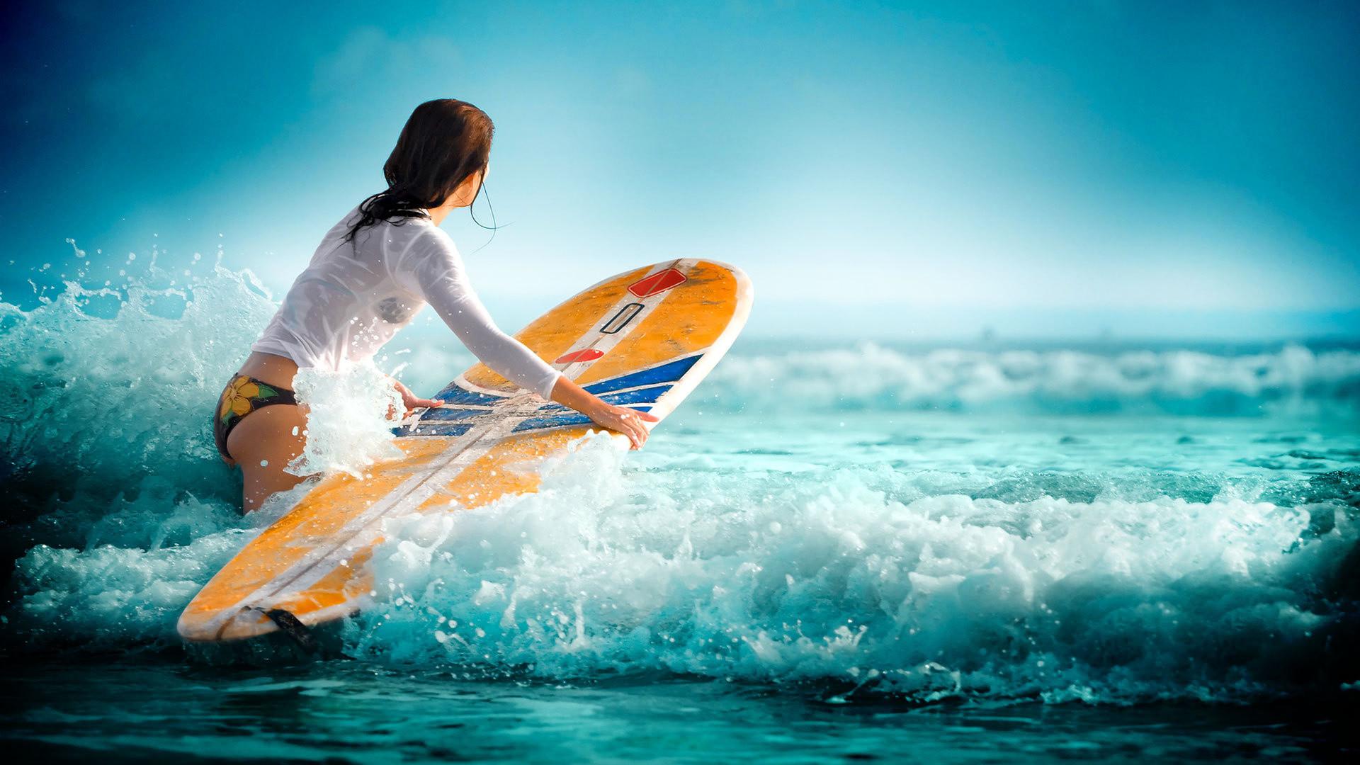 Surfing waves water sea girl wallpaper     117562 .