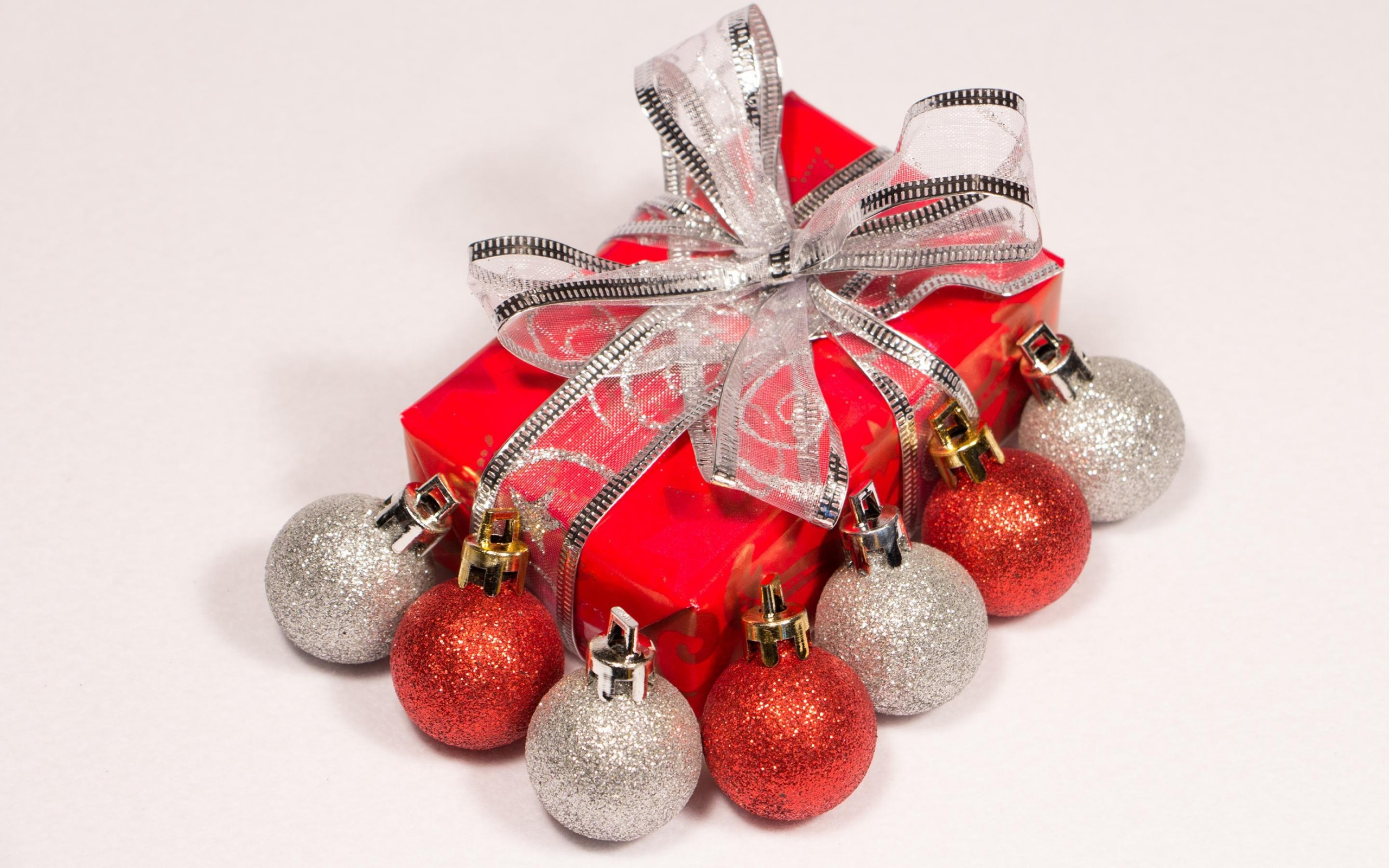 Red and silver baubles by the Christmas present