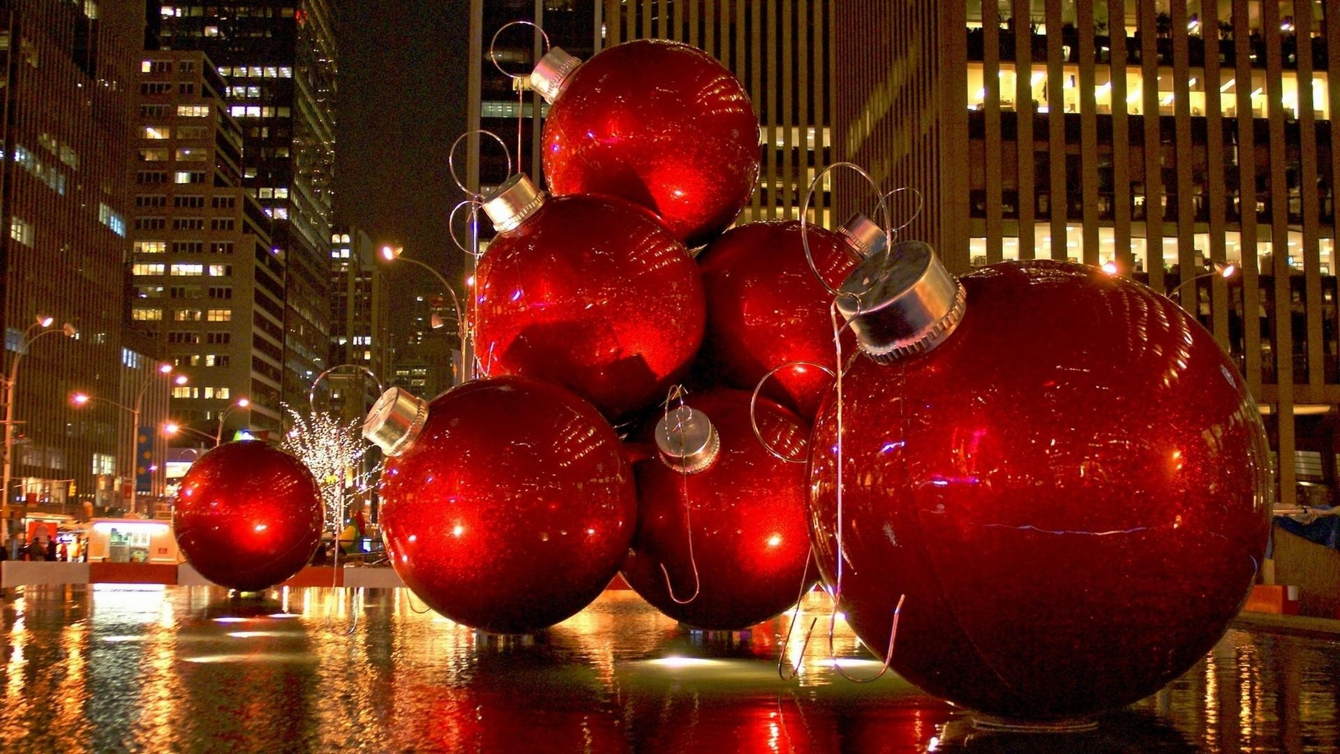Preview wallpaper christmas toys, balls, big, scenery, city, holiday  1920×1080