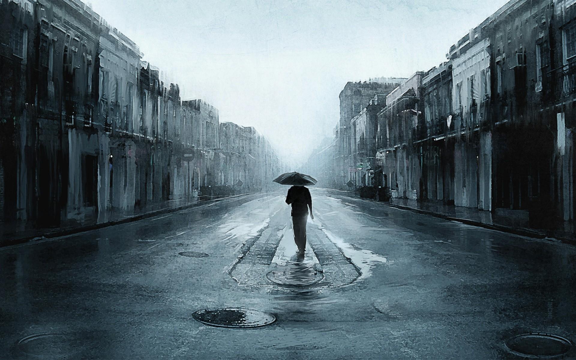 Lonely guy walking in the rain