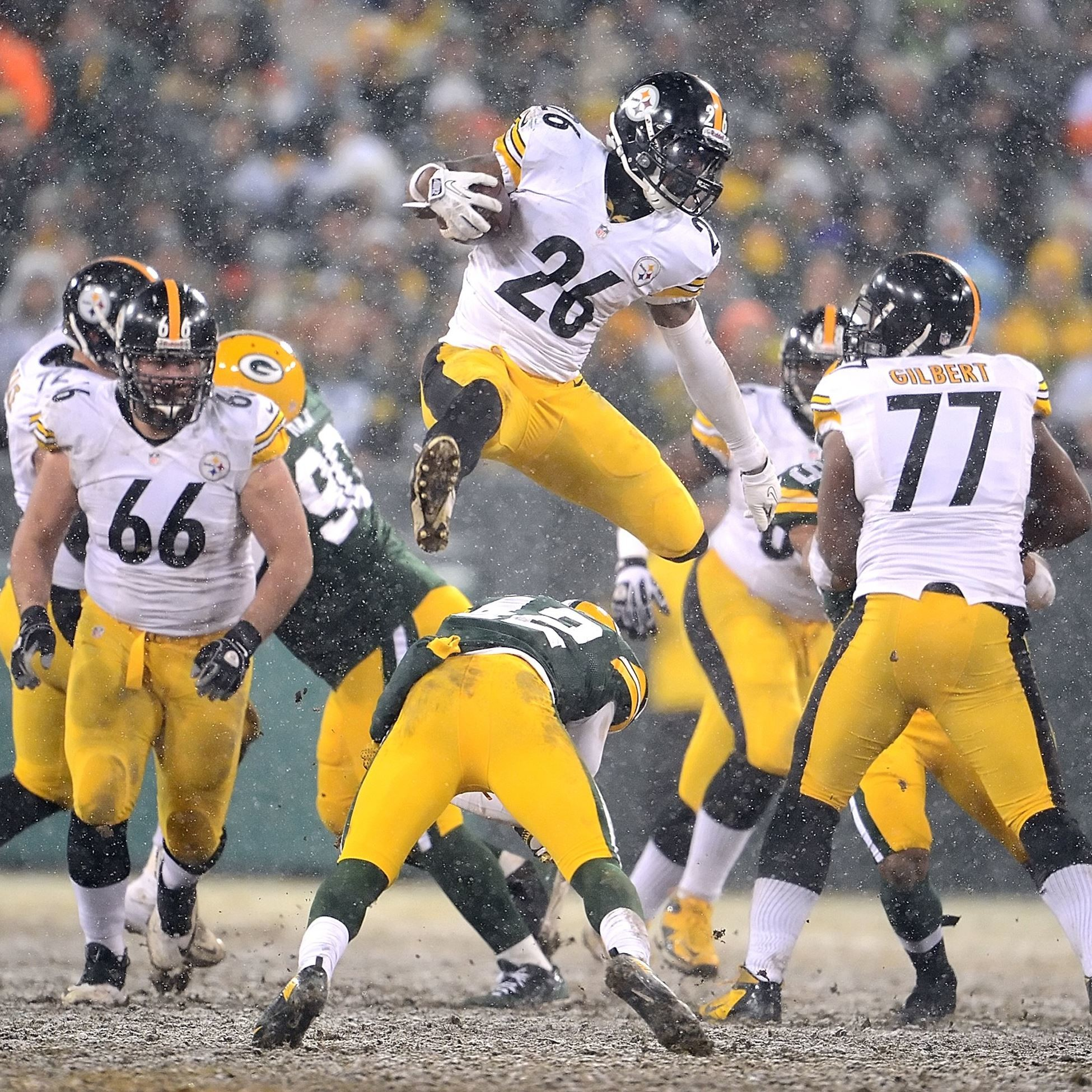 Steelers Le'Veon Bell leaps over Packers Morgan Burnett for first down  yardage in the third quarter at Lambeau Field.