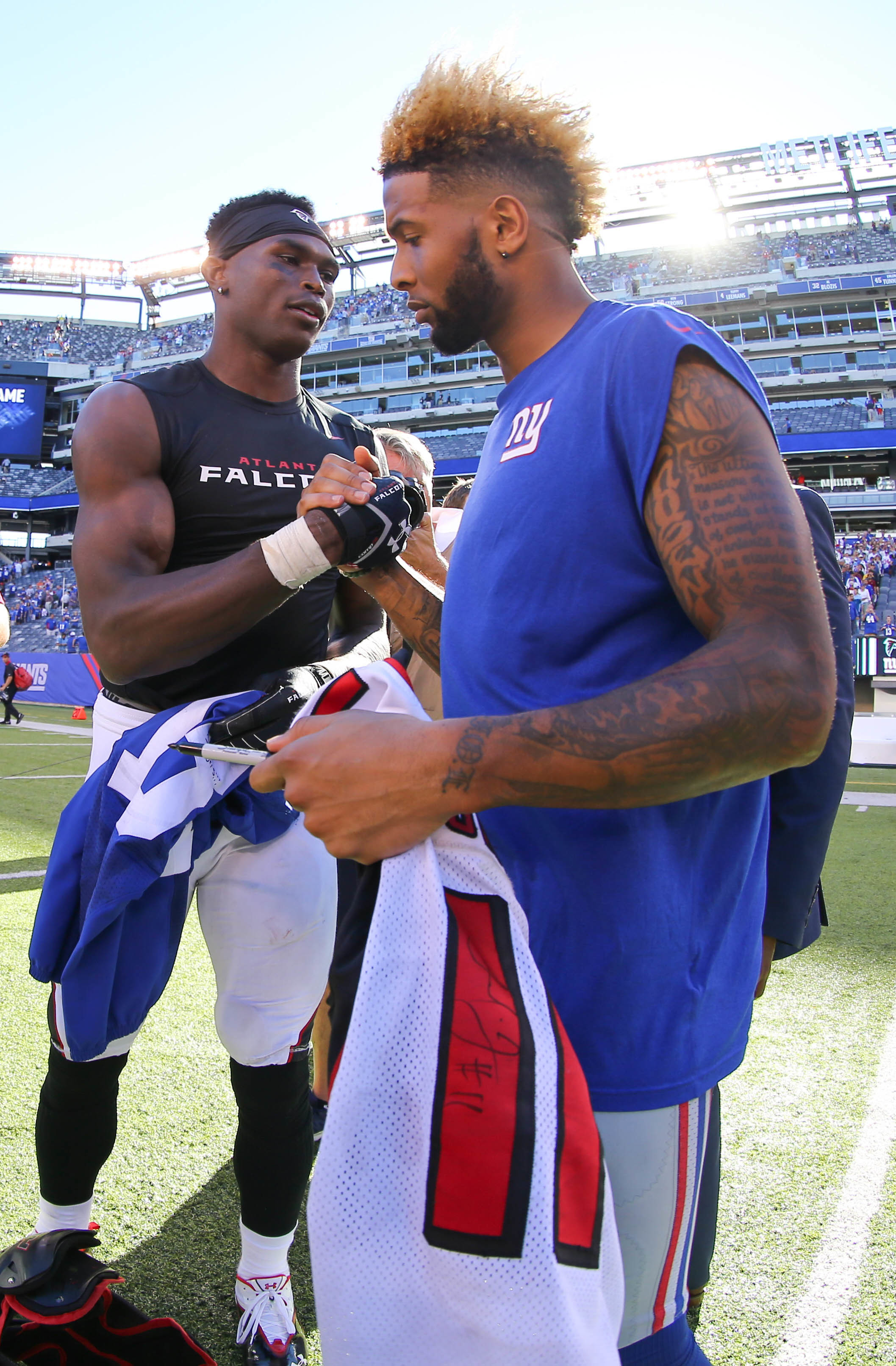 Atlanta Falcons wide receiver Julio Jones and New York Giants wide receiver Odell  Beckham Jr. exchange jerseys after their game at MetLife Stadium.