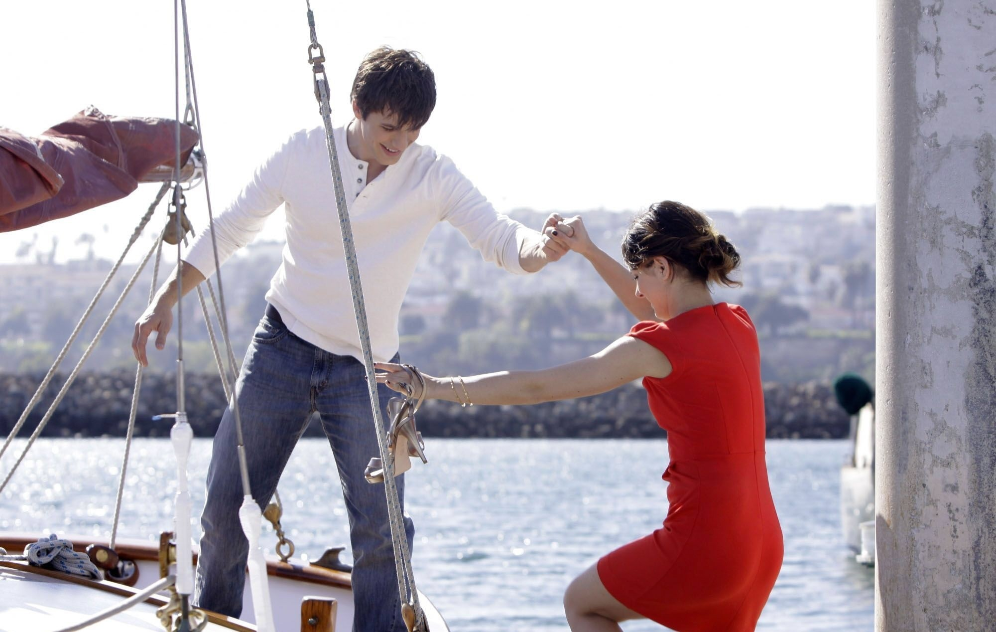 Cute guy and pretty girl on a boat