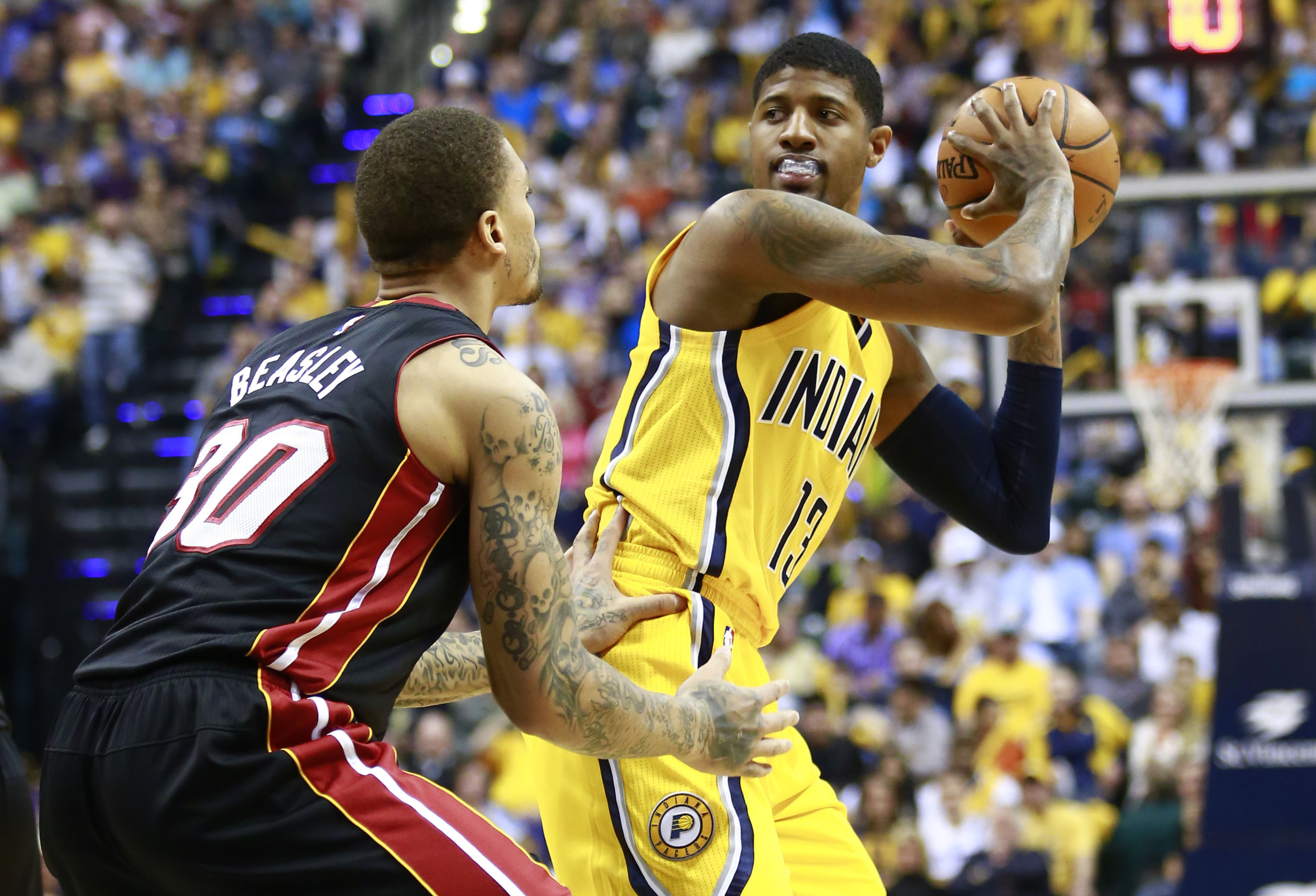 Back in the saddle: Pacers forward Paul George is defended by the Heat's  Michael Beasley