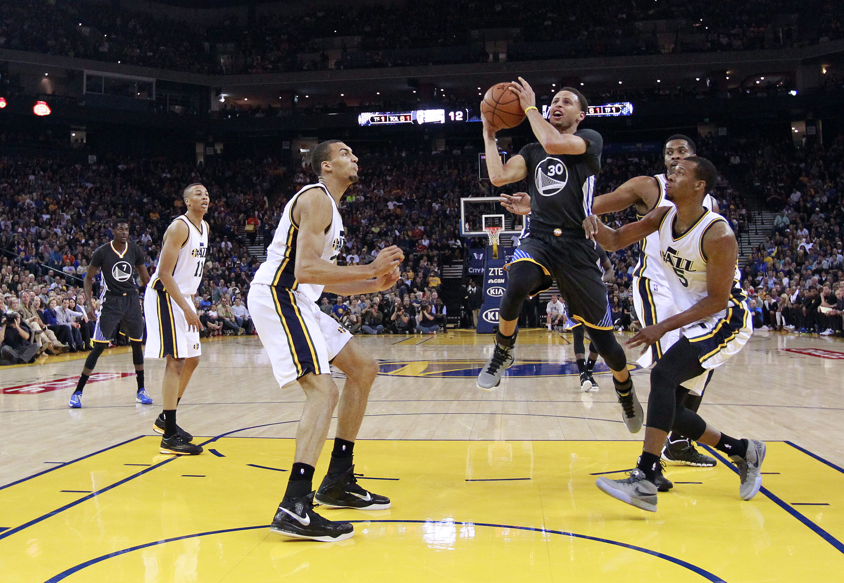 Tough to contain: Golden State's Stephen Curry goes up for a shot against  Utah in