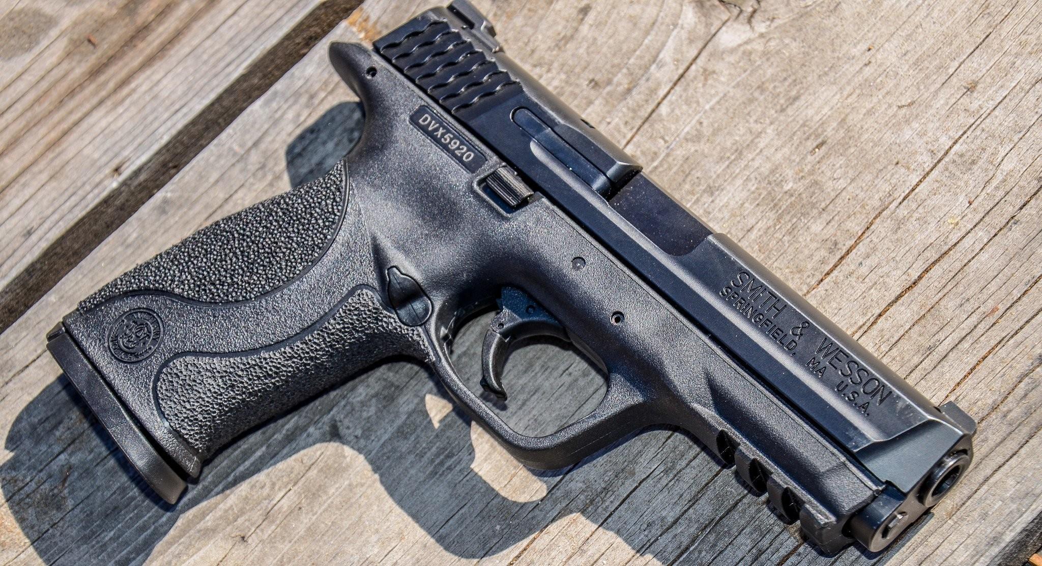 smith & wesson m&p springfield gun weapon background