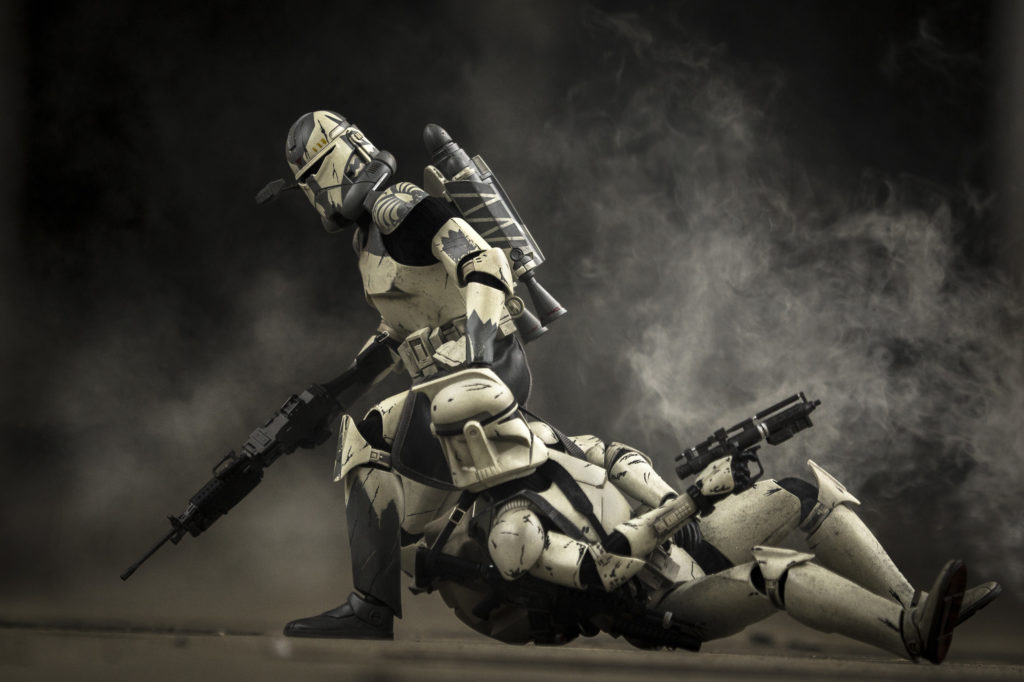 Clone Commander drags a wounded clone out of a kill zone after being