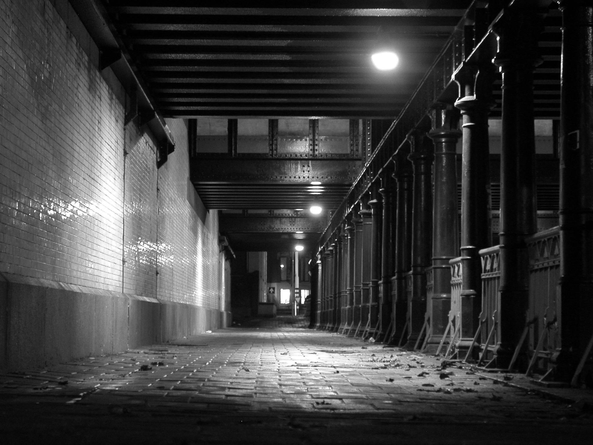 old railway station film noir black and white bridge bricks spooky dark  night nighttime
