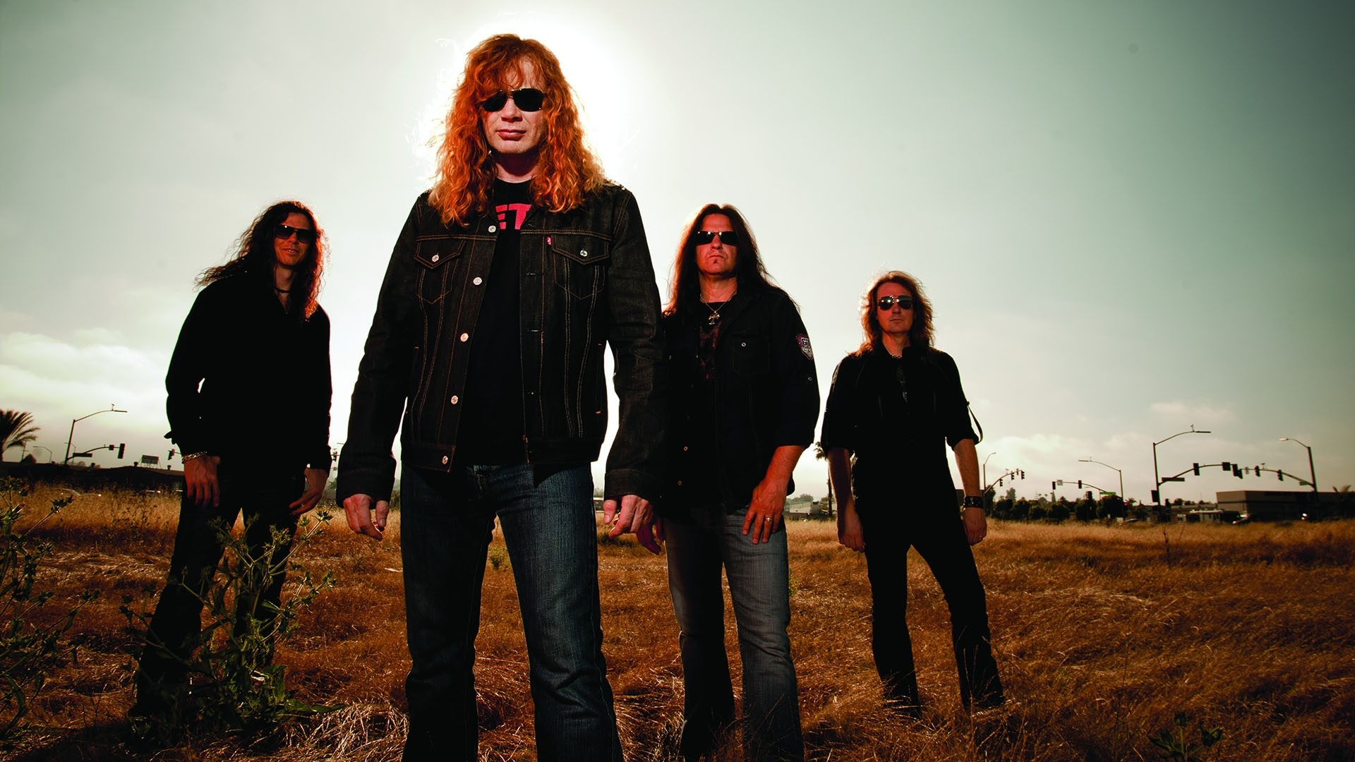 Preview wallpaper megadeth, band, field, sky, glasses 1920×1080