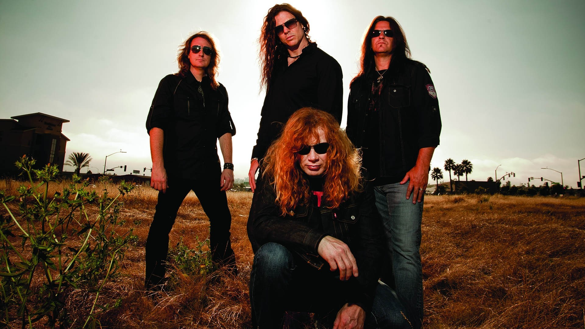 Preview wallpaper megadeth, band, glasses, sky, daylight 1920×1080