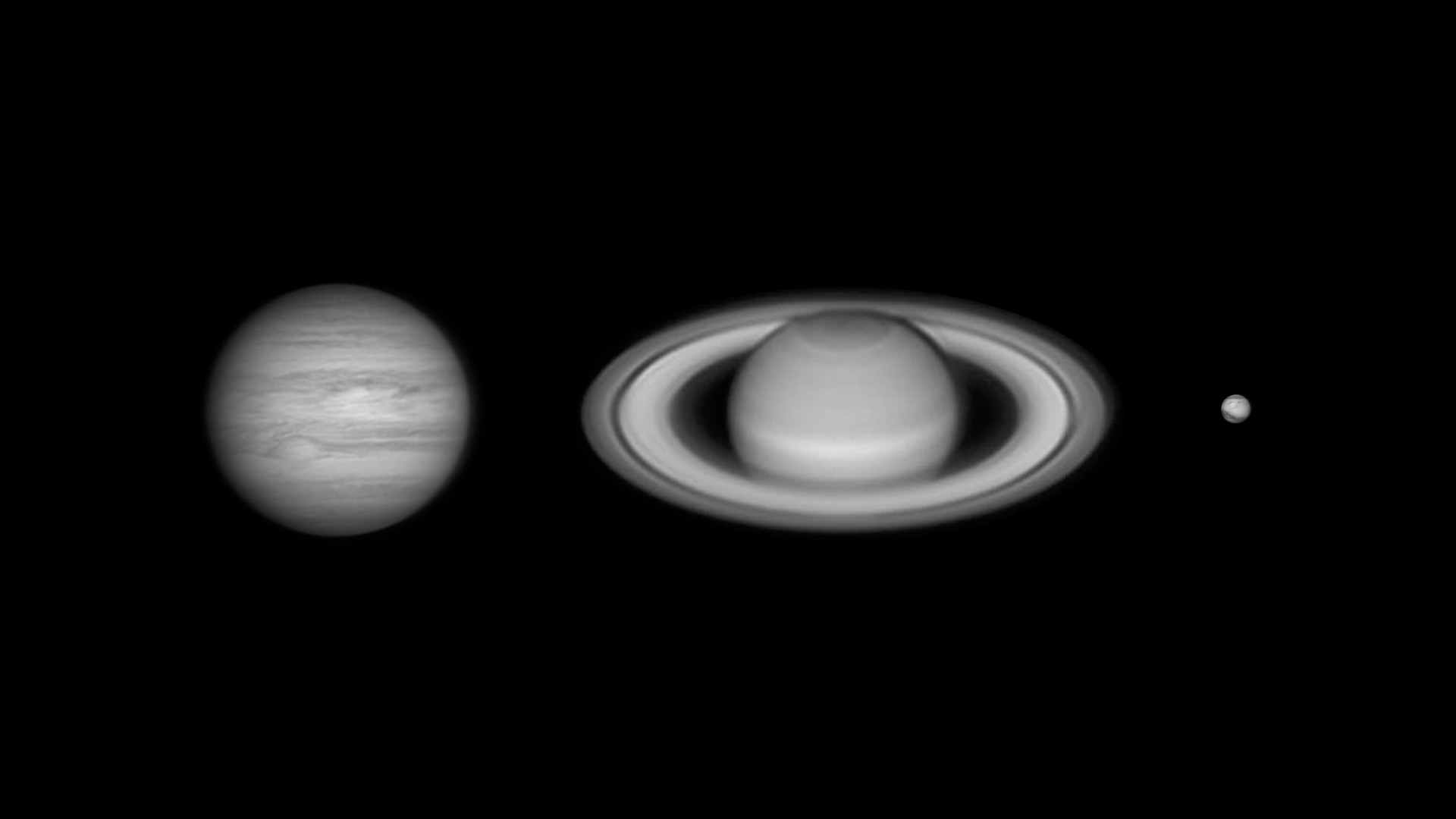 Black and white image of three planets.