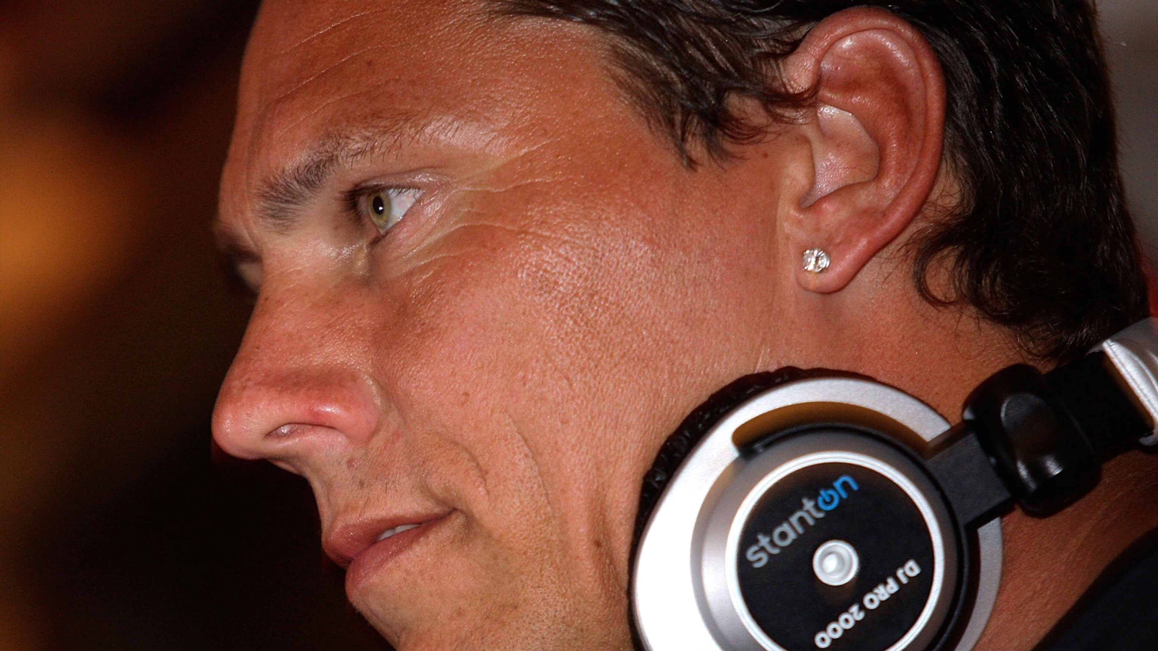Preview wallpaper dj tiesto, face, headphones, look, earrings 3840×2160