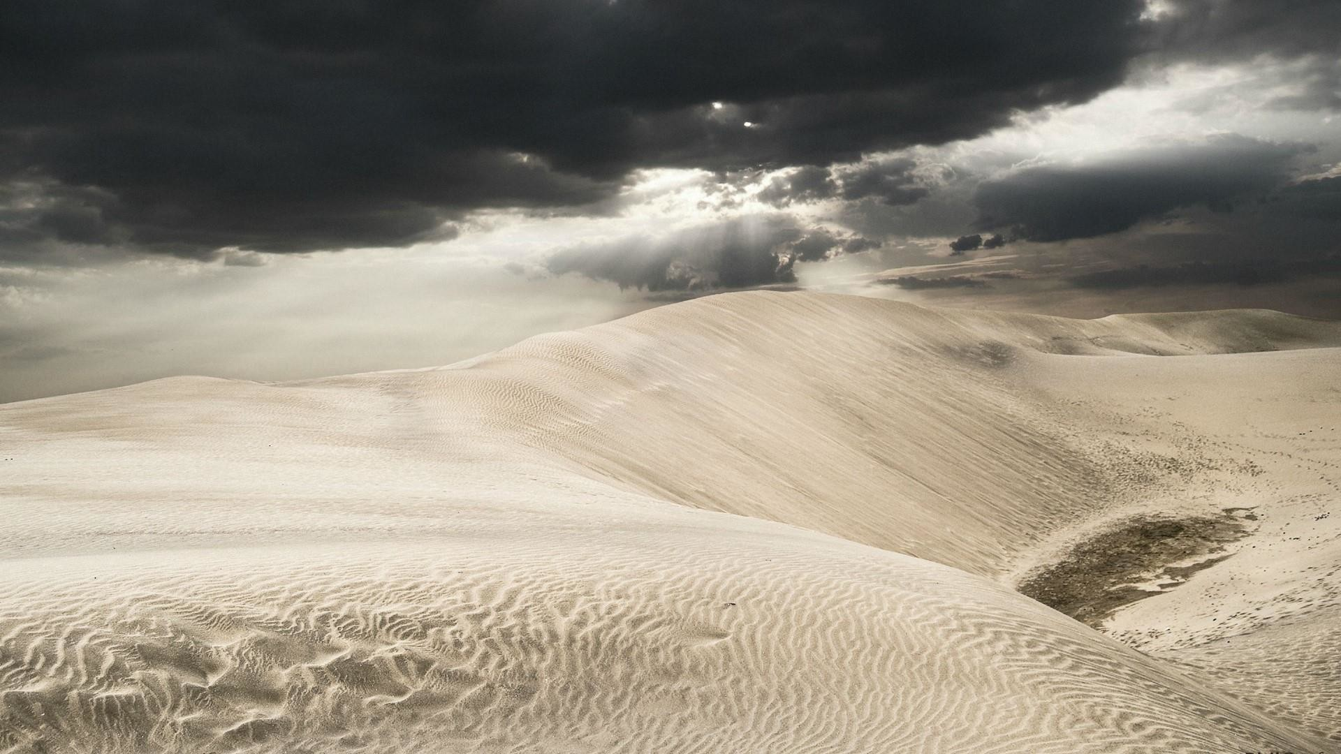 Beautiful cloudy sky above the desert wallpaper