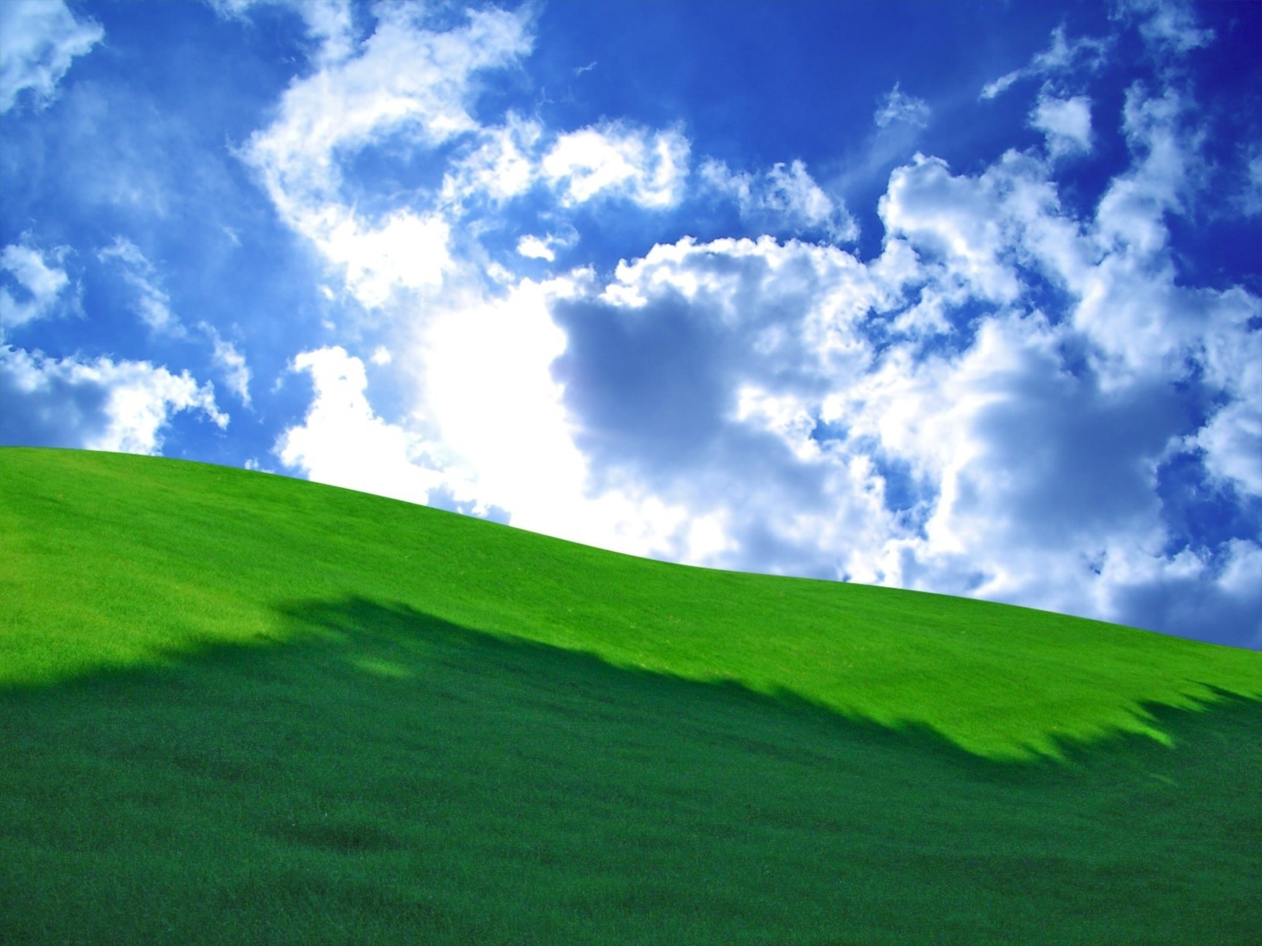 Grass Green Hill & Cloudy Sky wallpapers and stock photos