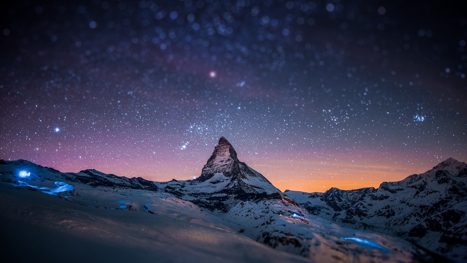 Preview wallpaper mountain, peak, stars, sky, night, light, snow 1920×1080