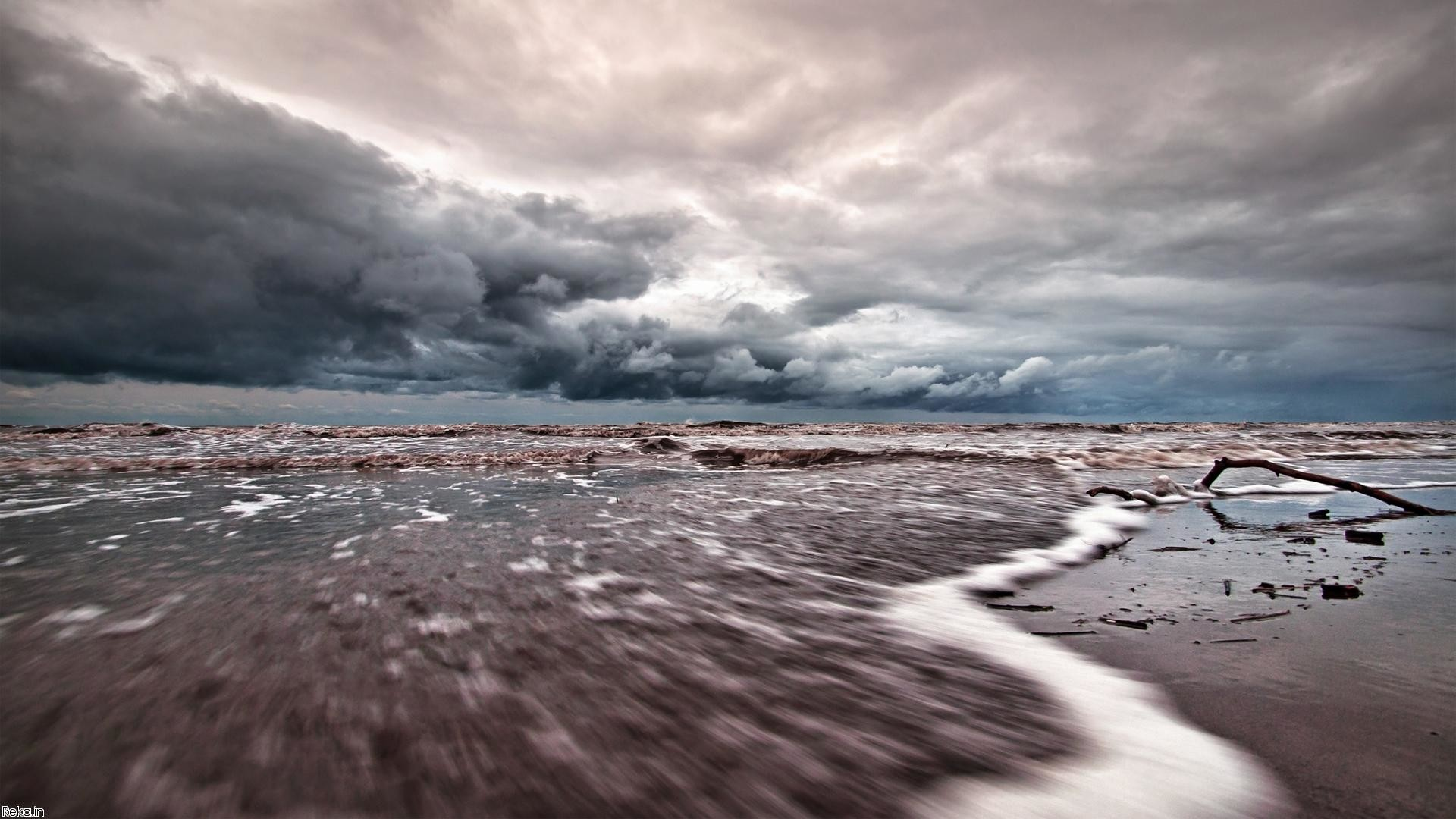 Tide Coming In Under Stormy Skies wallpaper