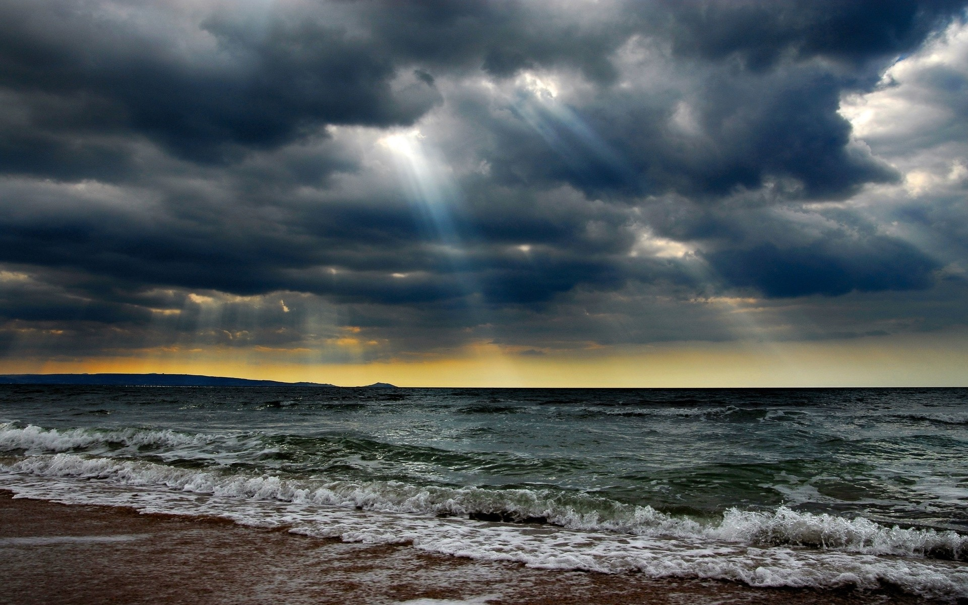 Ocean Stormy Clouds Sun Rays wallpapers and stock photos