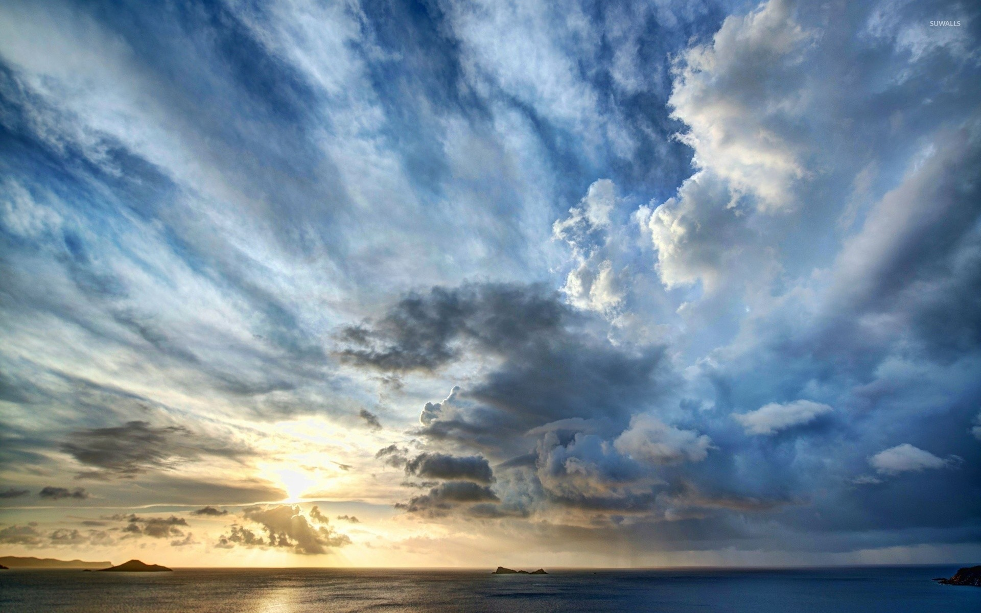 Stormy clouds above the ocean at sunset wallpaper