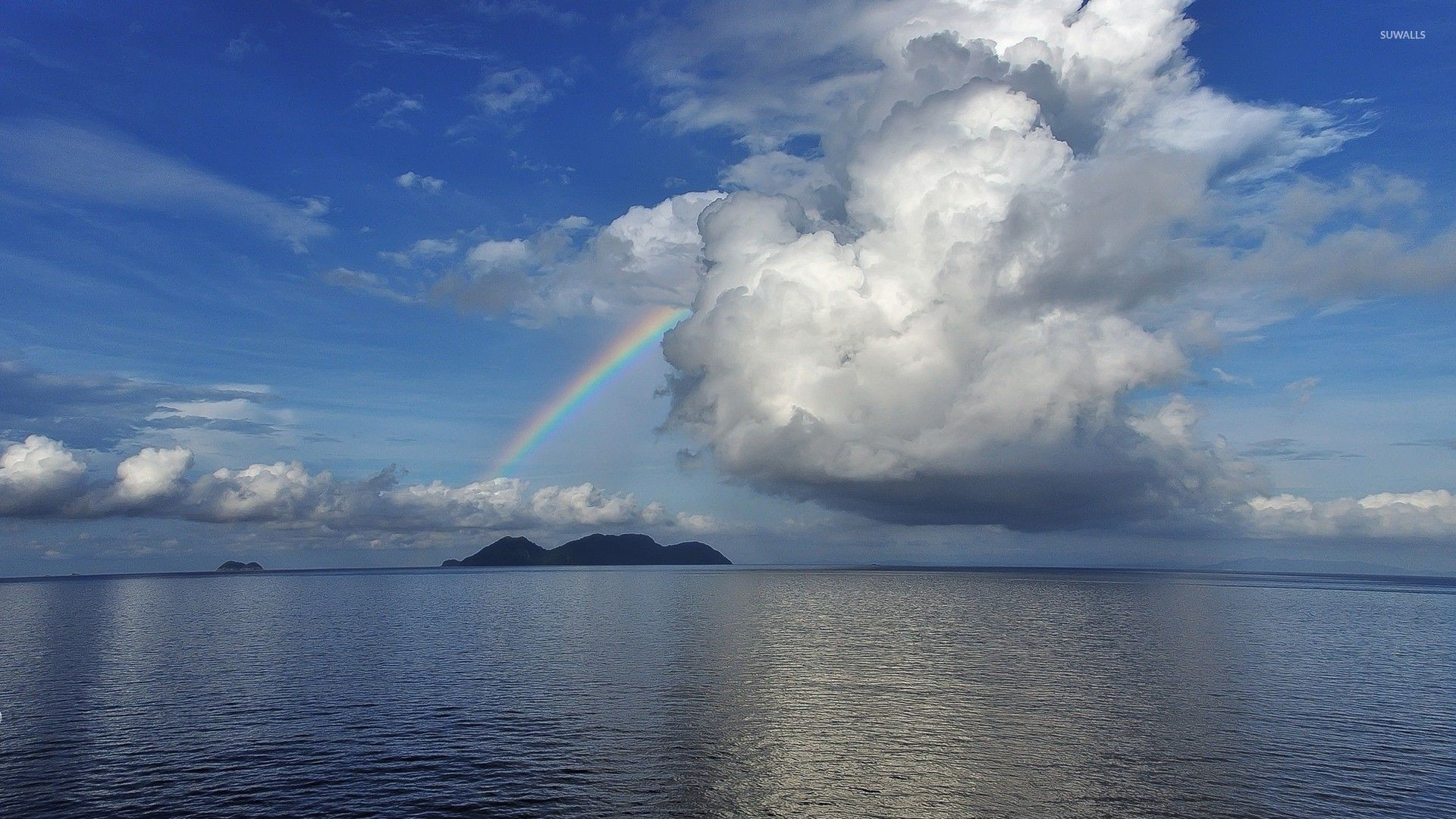 Rainbow in the middle of the ocean wallpaper jpg