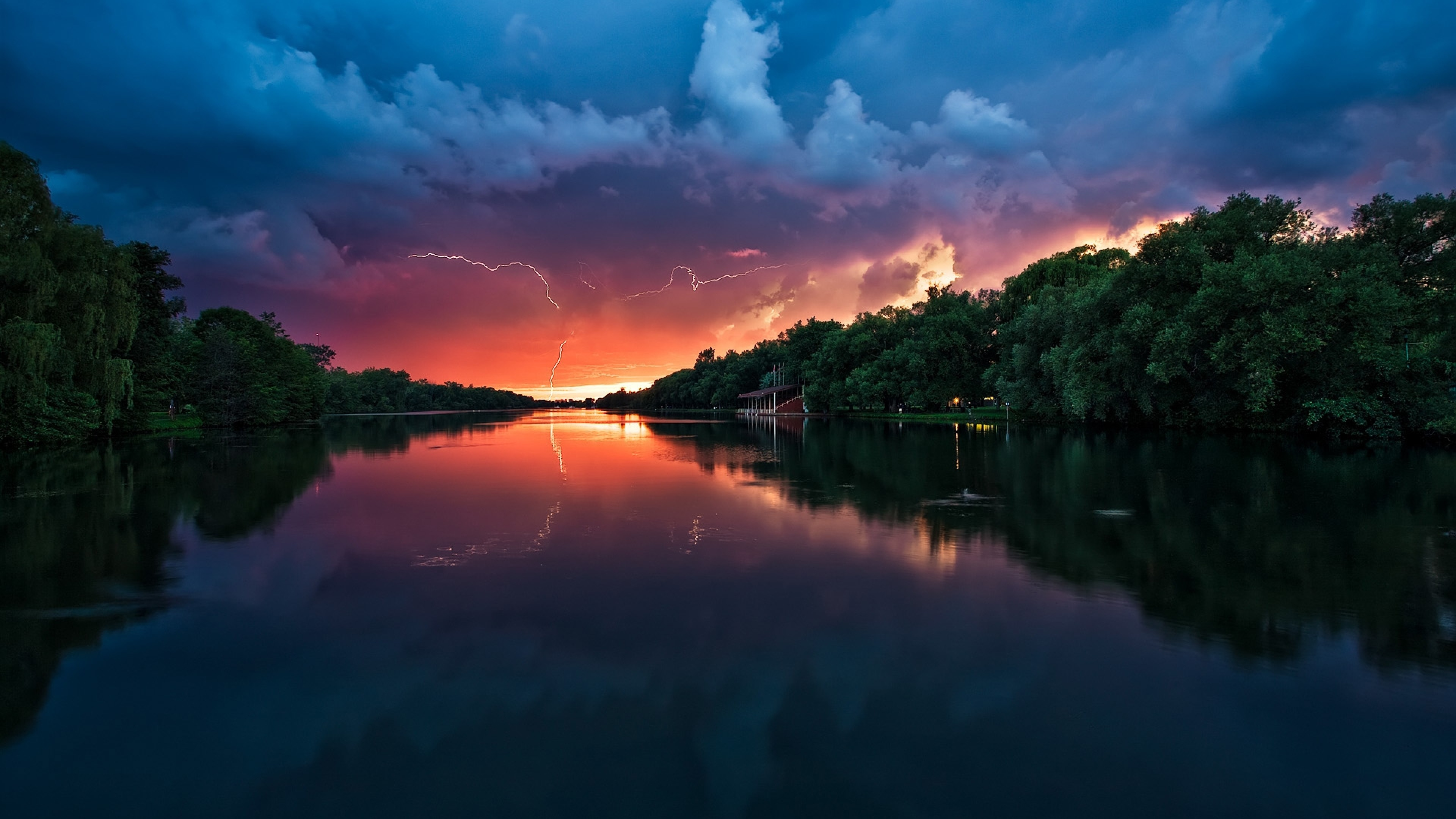 Preview wallpaper clouds, thunder-storm, river, reflection, lightning,  trees 3840×2160