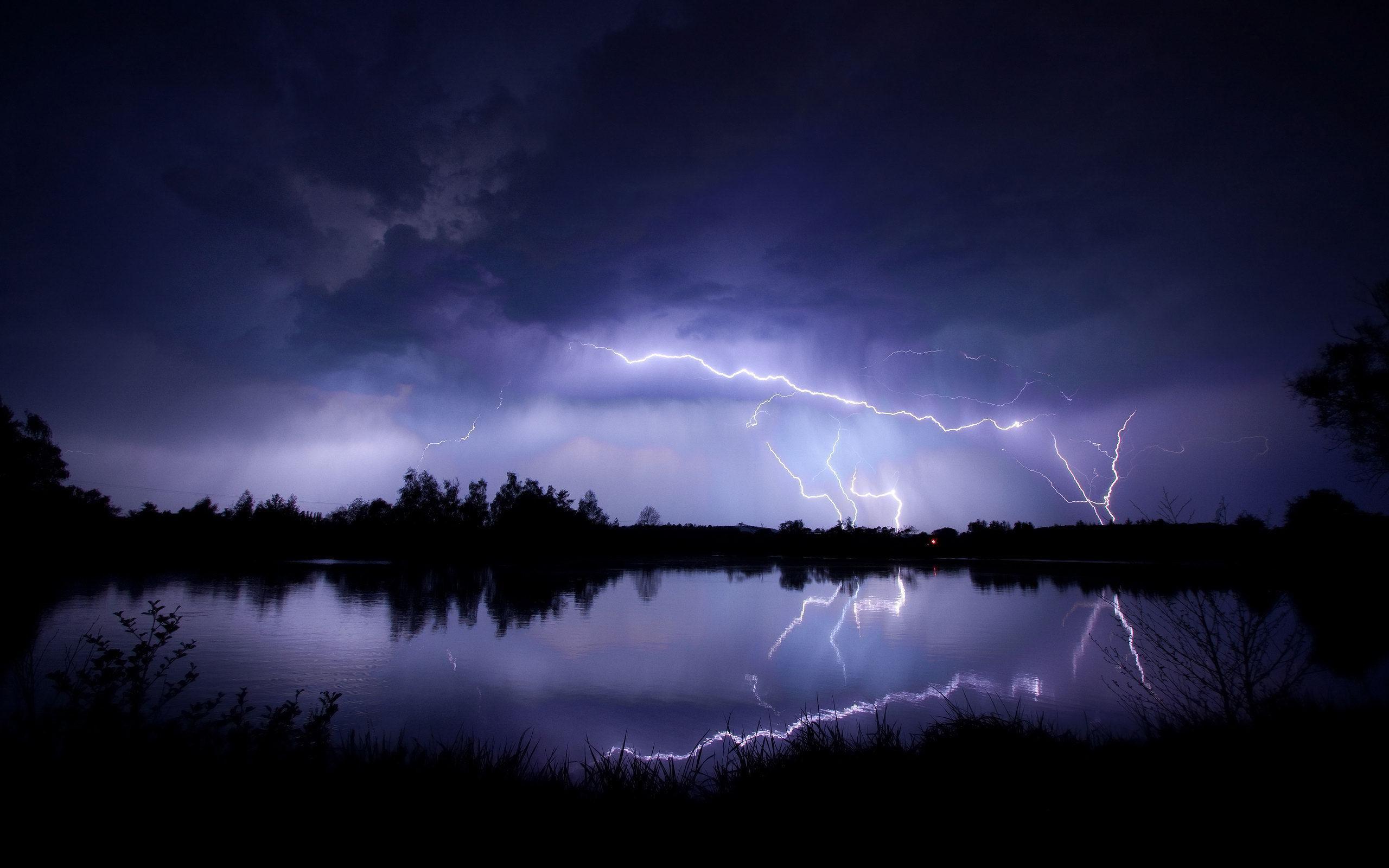 Lightning-striking-the-lakeside-night-storm-nature-hd-