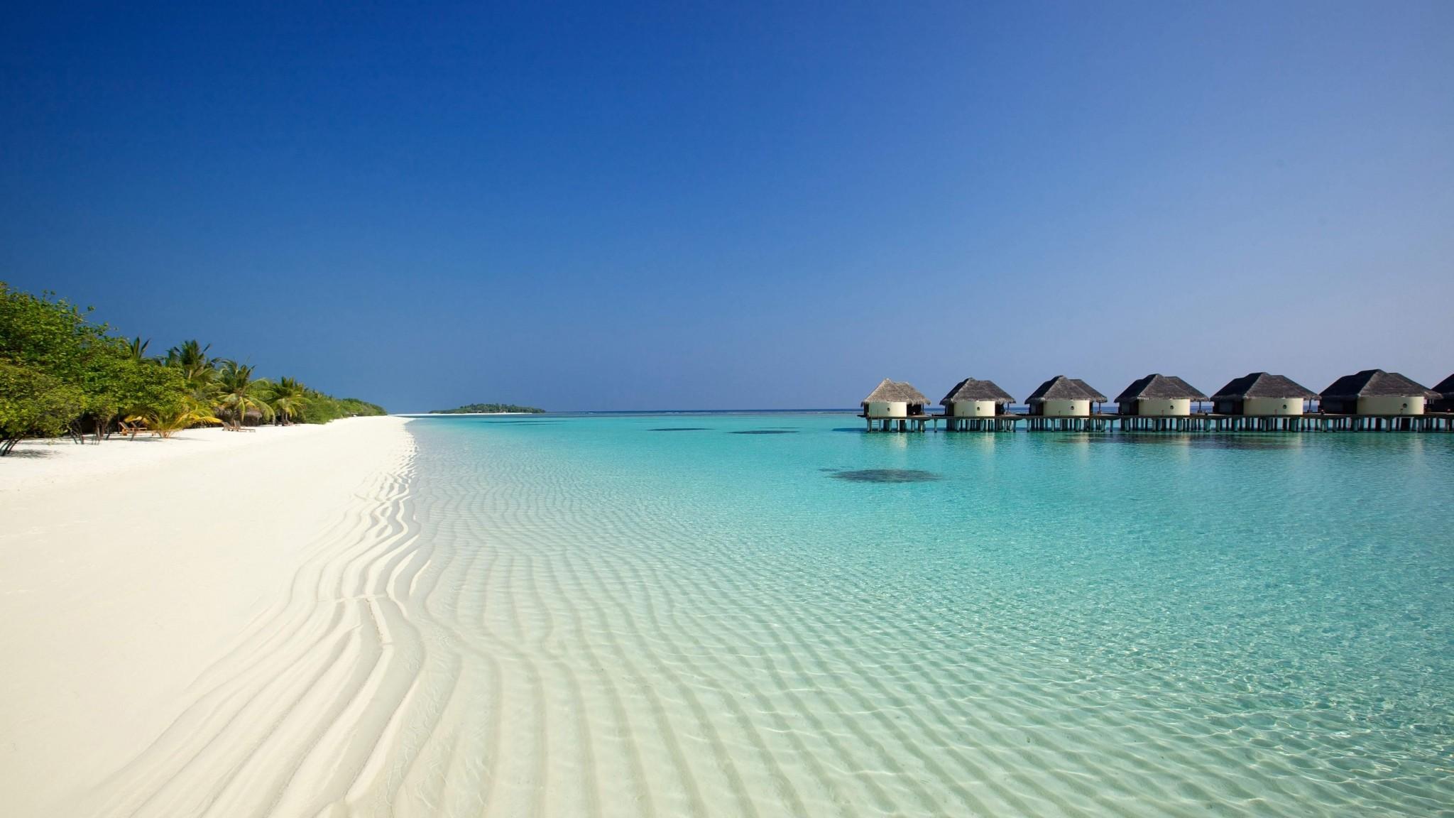 Preview wallpaper beach, ocean, sand, palm trees, bungalows 2048×1152