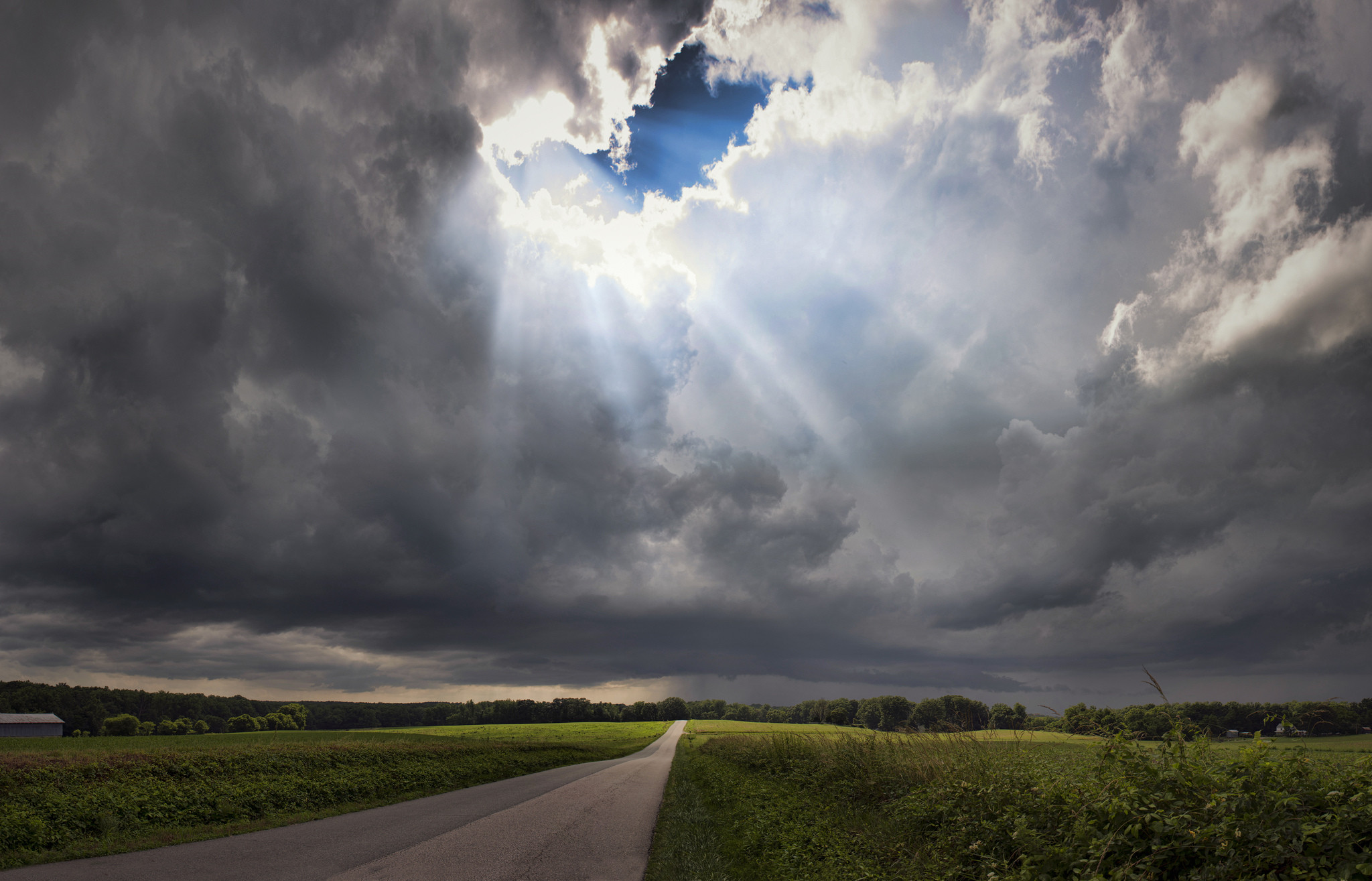 Field grass trees road sky skylight rays clouds storm wallpaper      112739   WallpaperUP