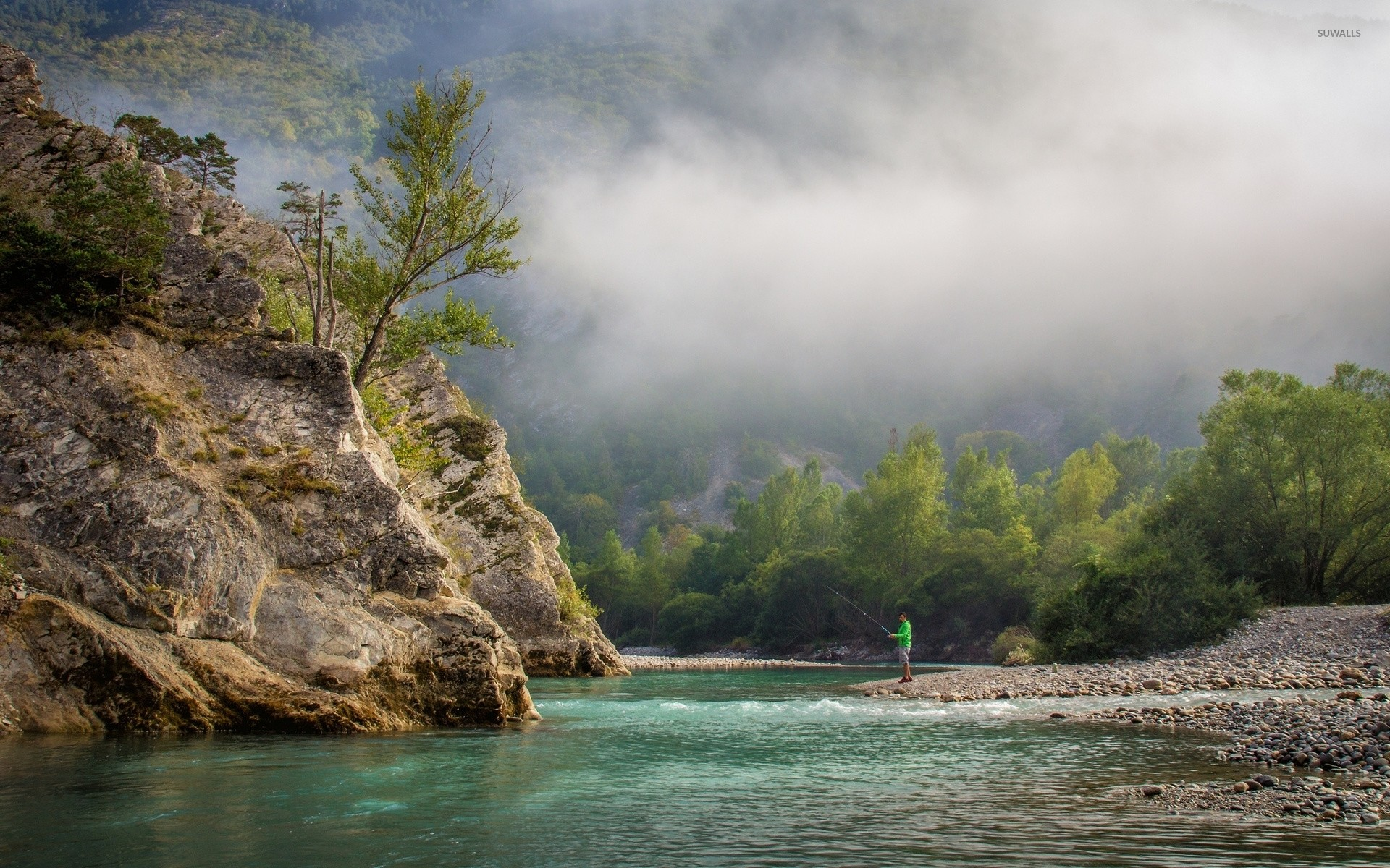 Fishing near the foggy forest mountain wallpaper