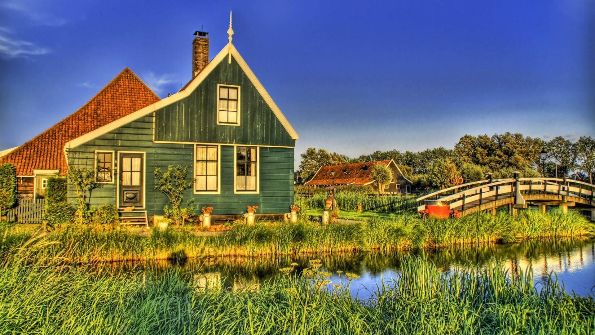 Preview wallpaper village, house, bridge, river, grass, sky, summer,