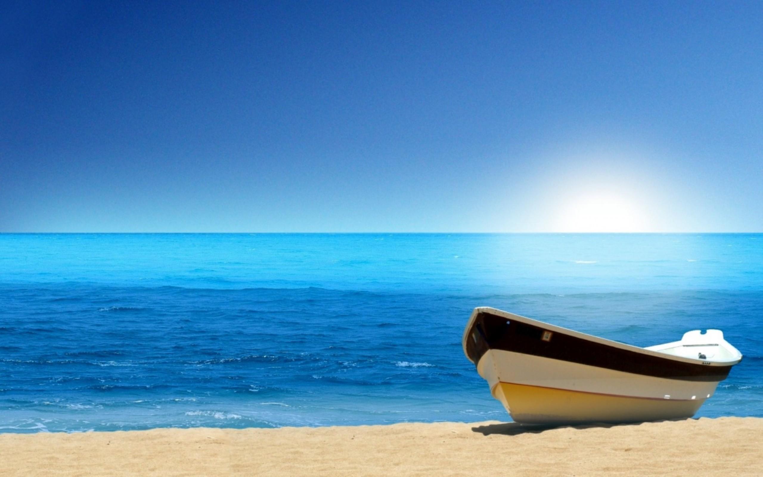 Boat Blue Ocean Beach Wallpaper.