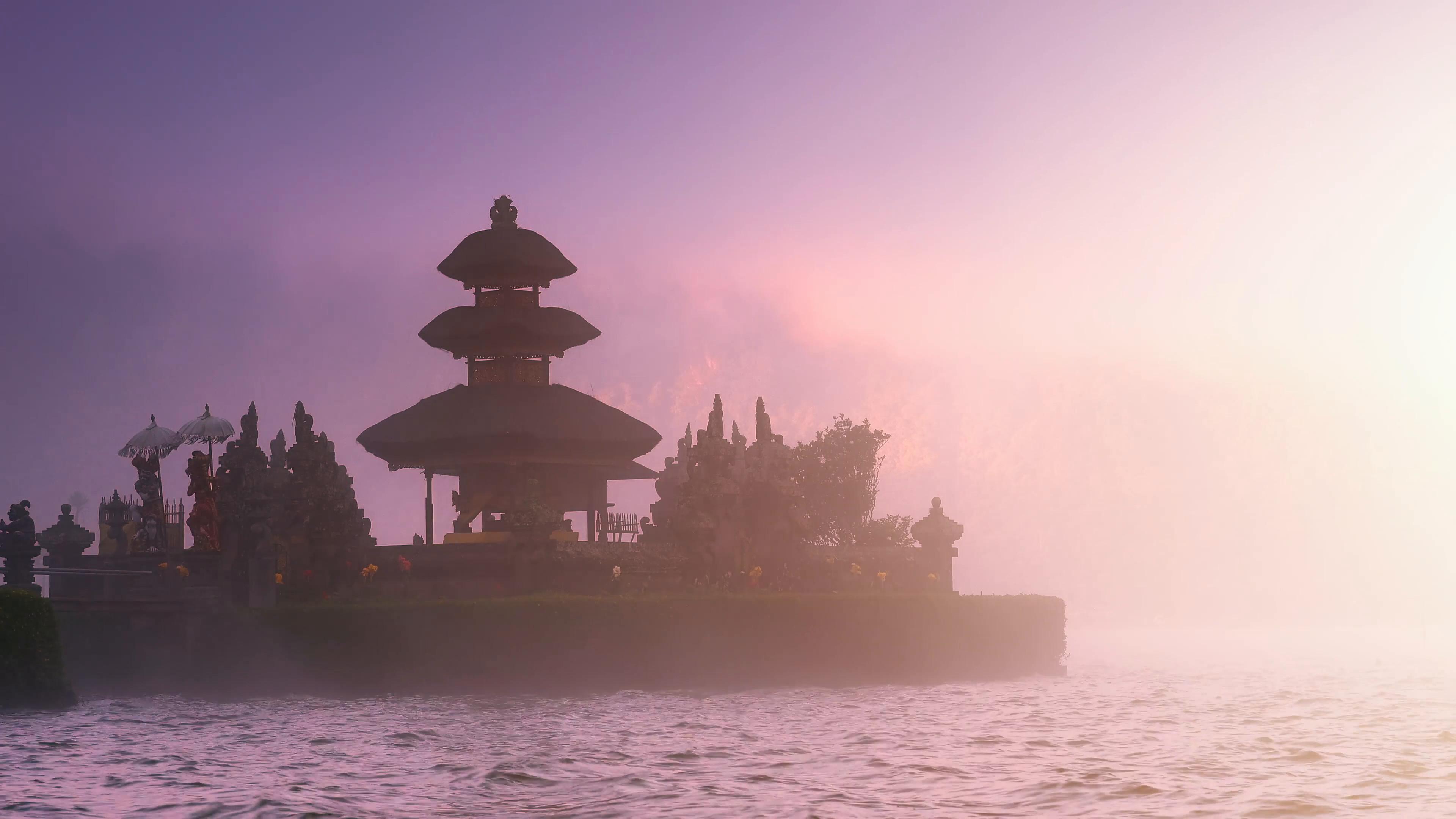 Scenic background of beautiful Bali temple in mist on lake under sunset  sunlight Stock Video Footage – VideoBlocks