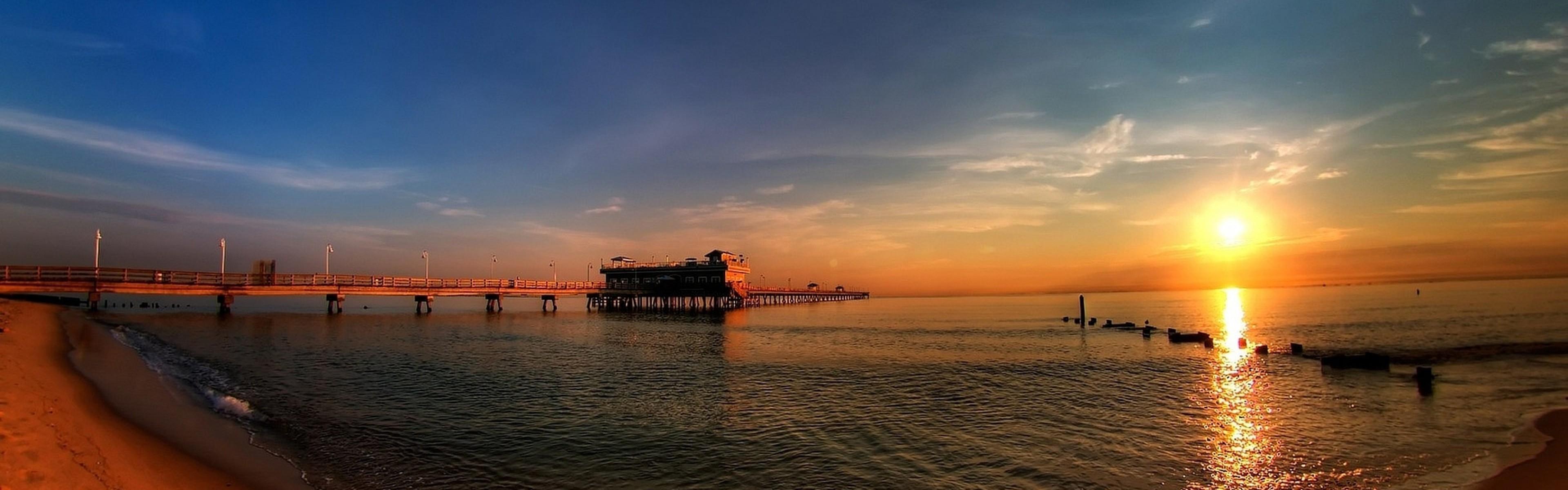 Preview wallpaper panorama, pier, coast, decline 3840×1200