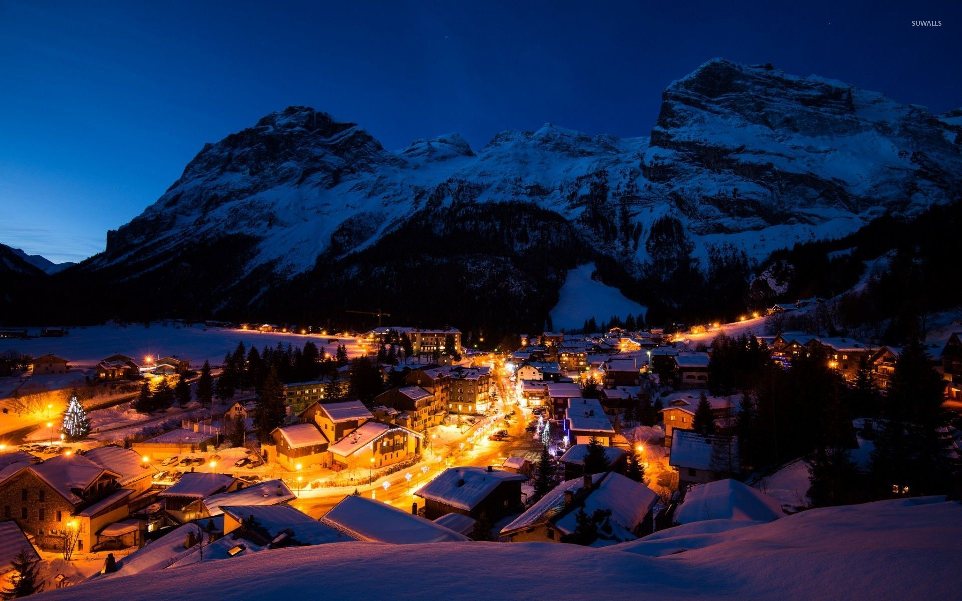 Night lights in the snowy mountain town wallpaper