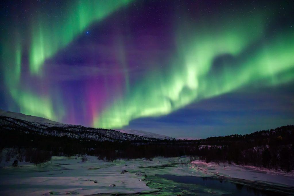 aurora borealis northern lights sky star mountain night snow