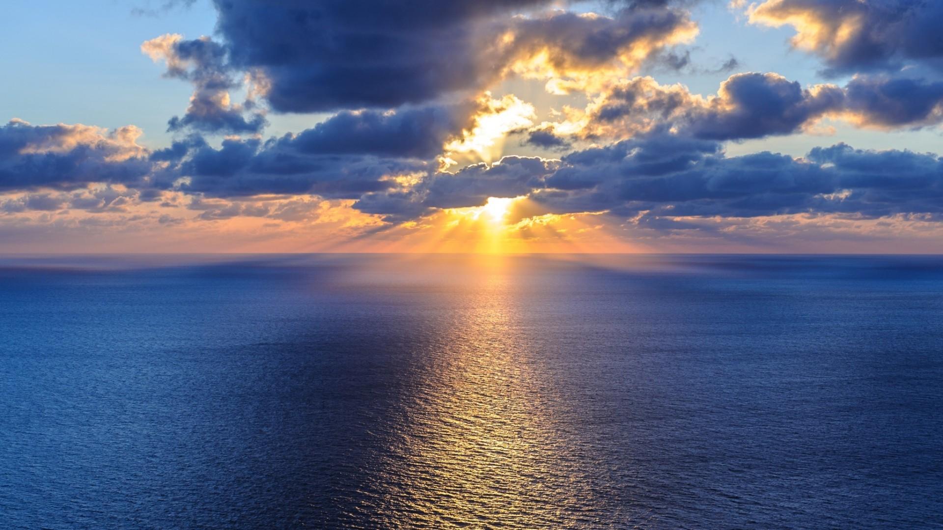 Beautiful ocean, sky, horizon, clouds, sun, water: