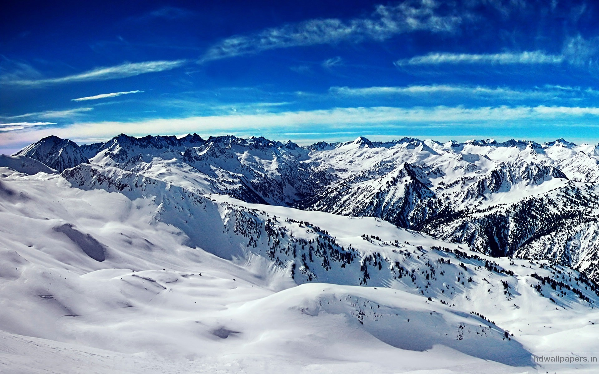 Beautiful scene of snow on the mountains and blue sky is a lovely present.  Description