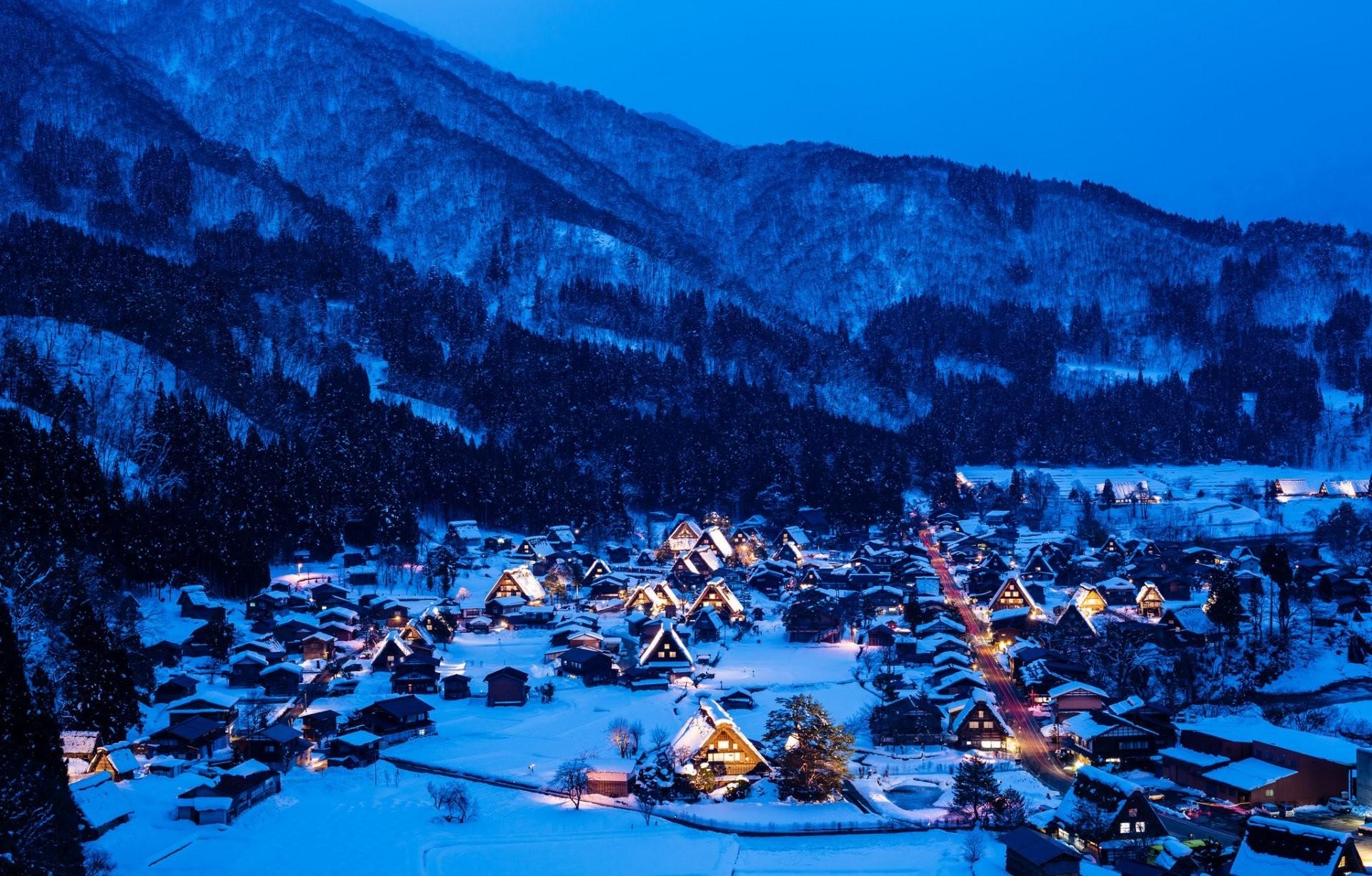sirakava- th gokayama the island of honshu japan night lights house  mountain winter snow