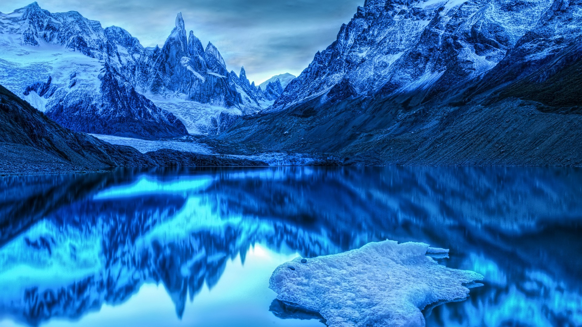 Lake In The Snowy Mountains Wallpaper