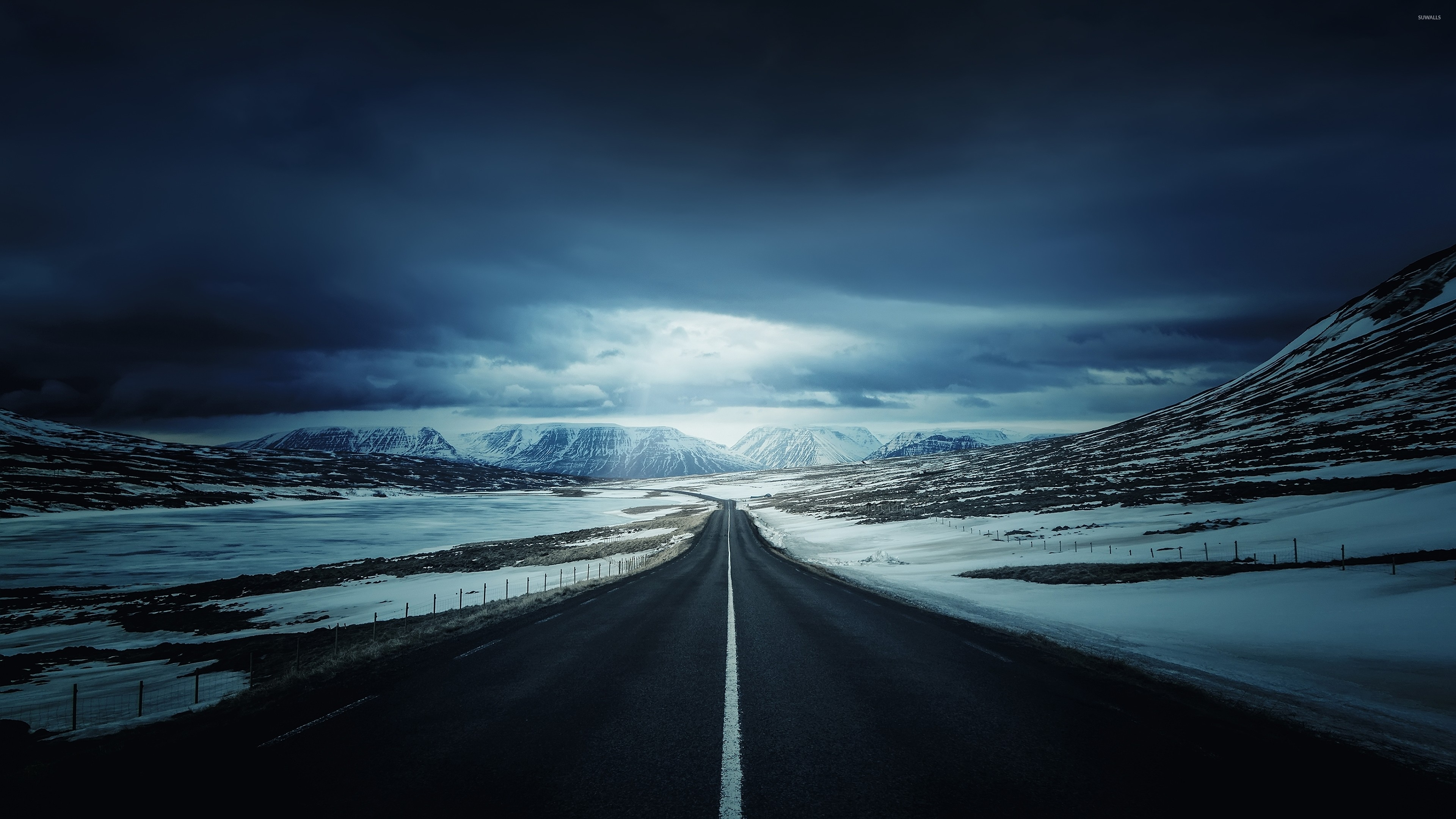 Road towards the snowy mountains wallpaper