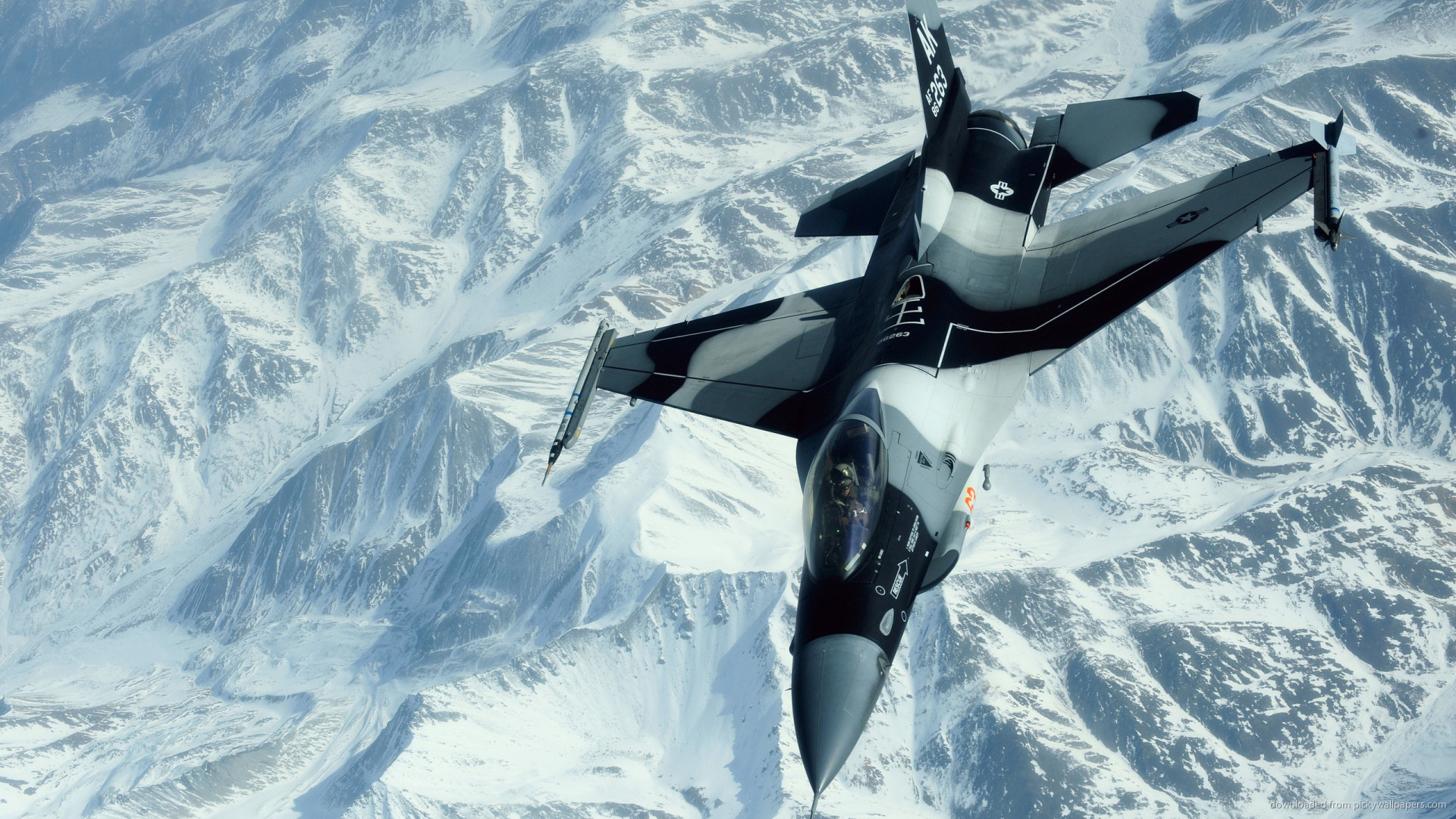 F16 over snowy mountains picture