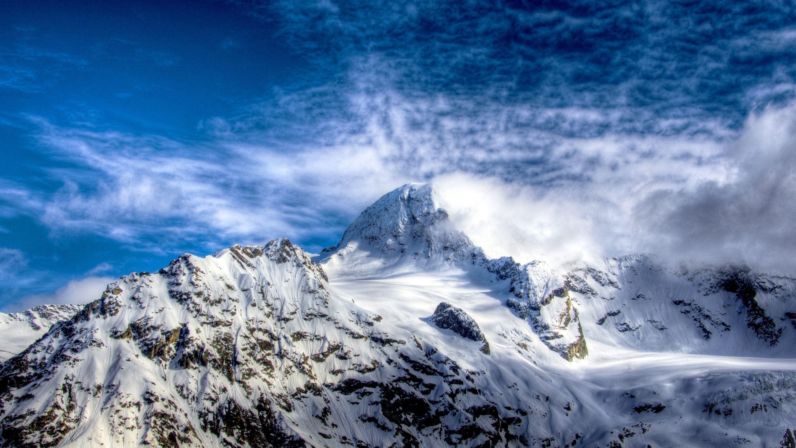 Clear Sky Snowy Mountains