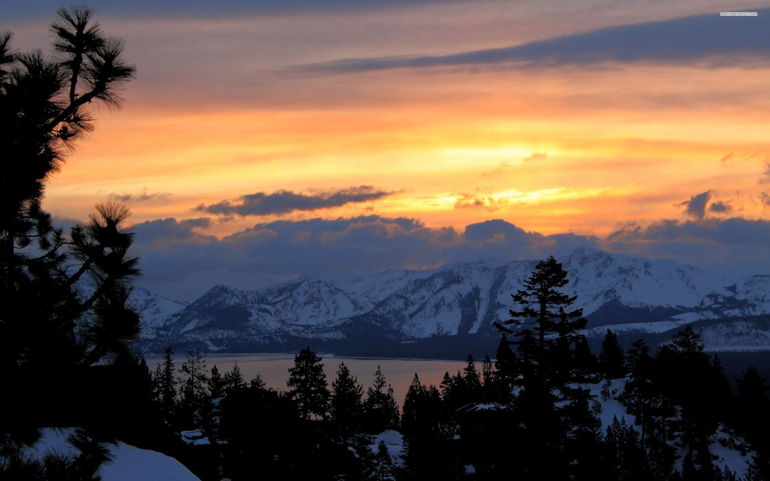 Beautiful Snowy Mountains In The Sunset