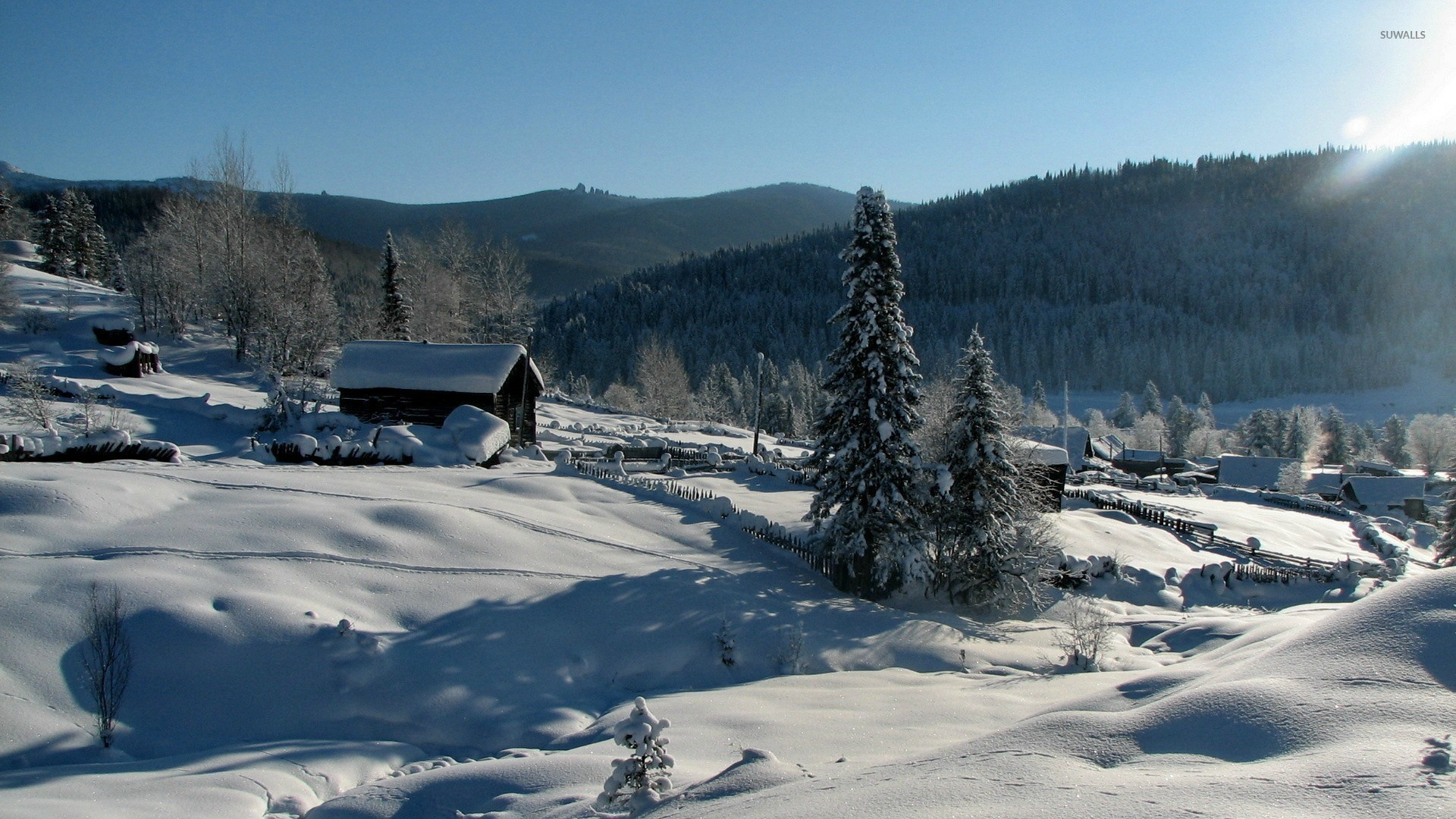 Wooden houses on a snowy mountain wallpaper jpg