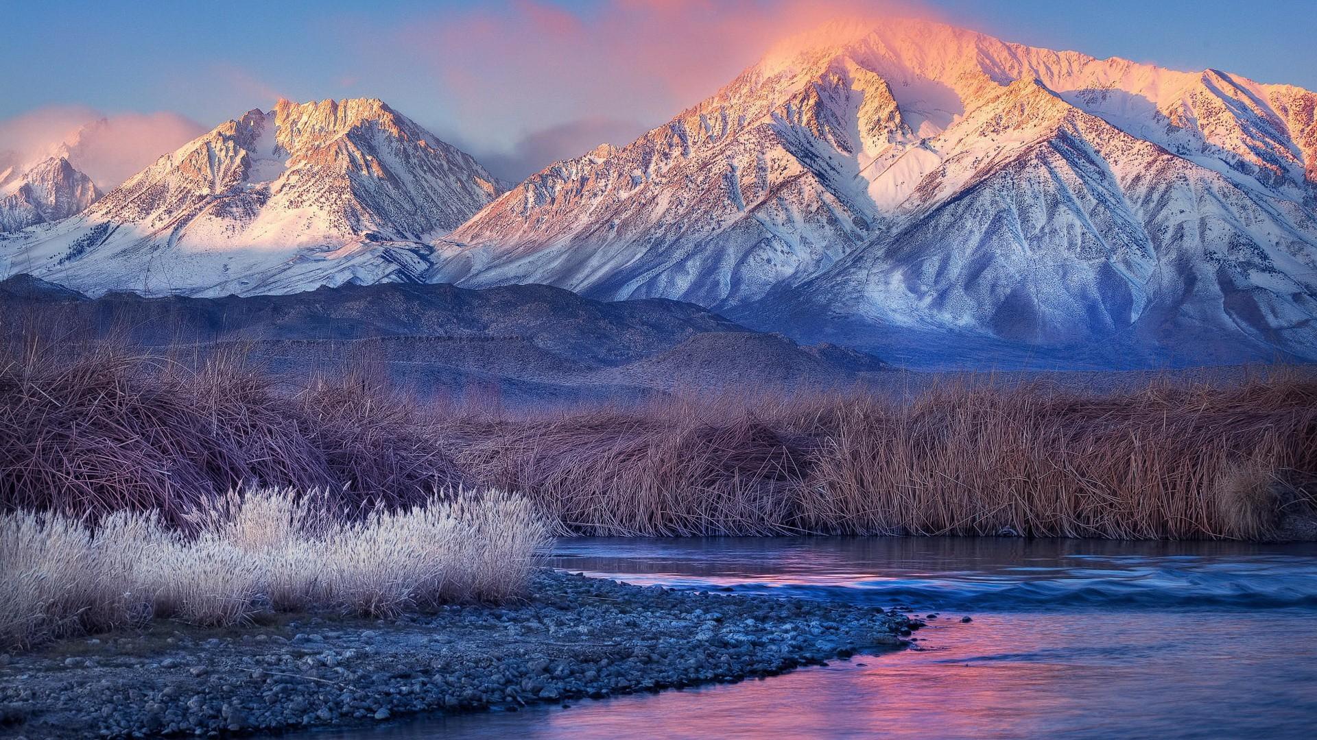 Sunset on Snow Clad Mountains