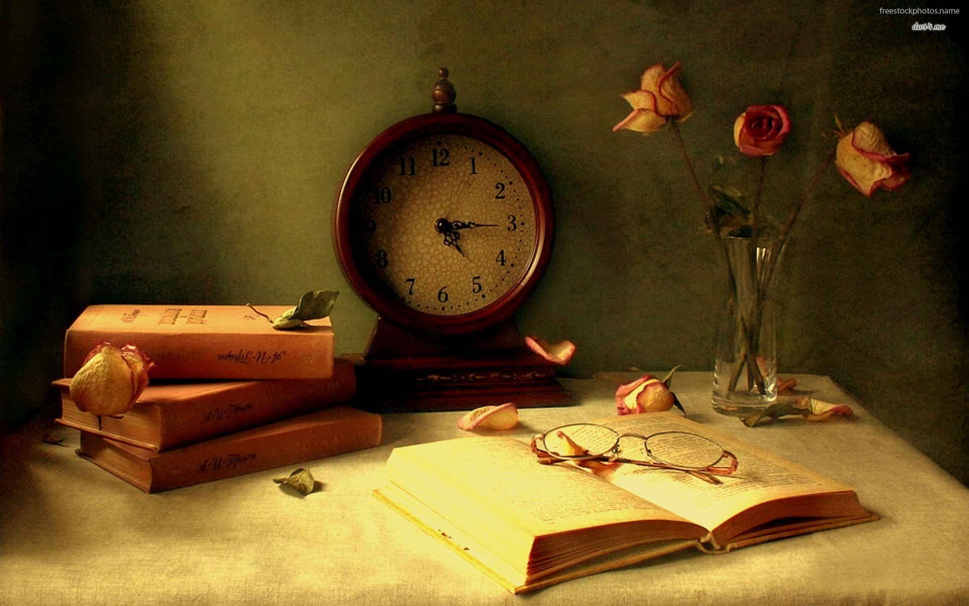 download Books and a old watch on the table