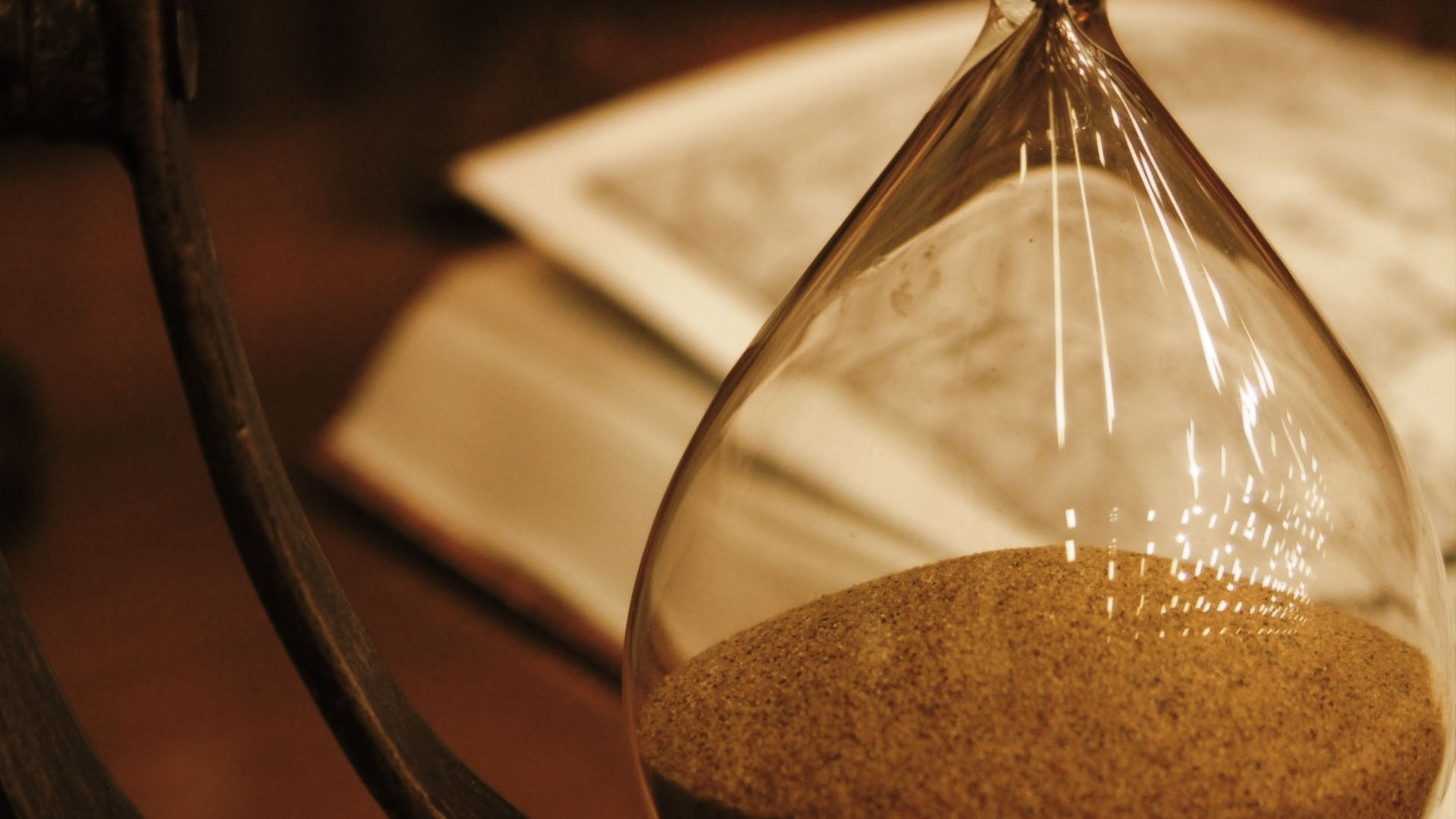 Preview wallpaper hourglass, glass, book 1920×1080