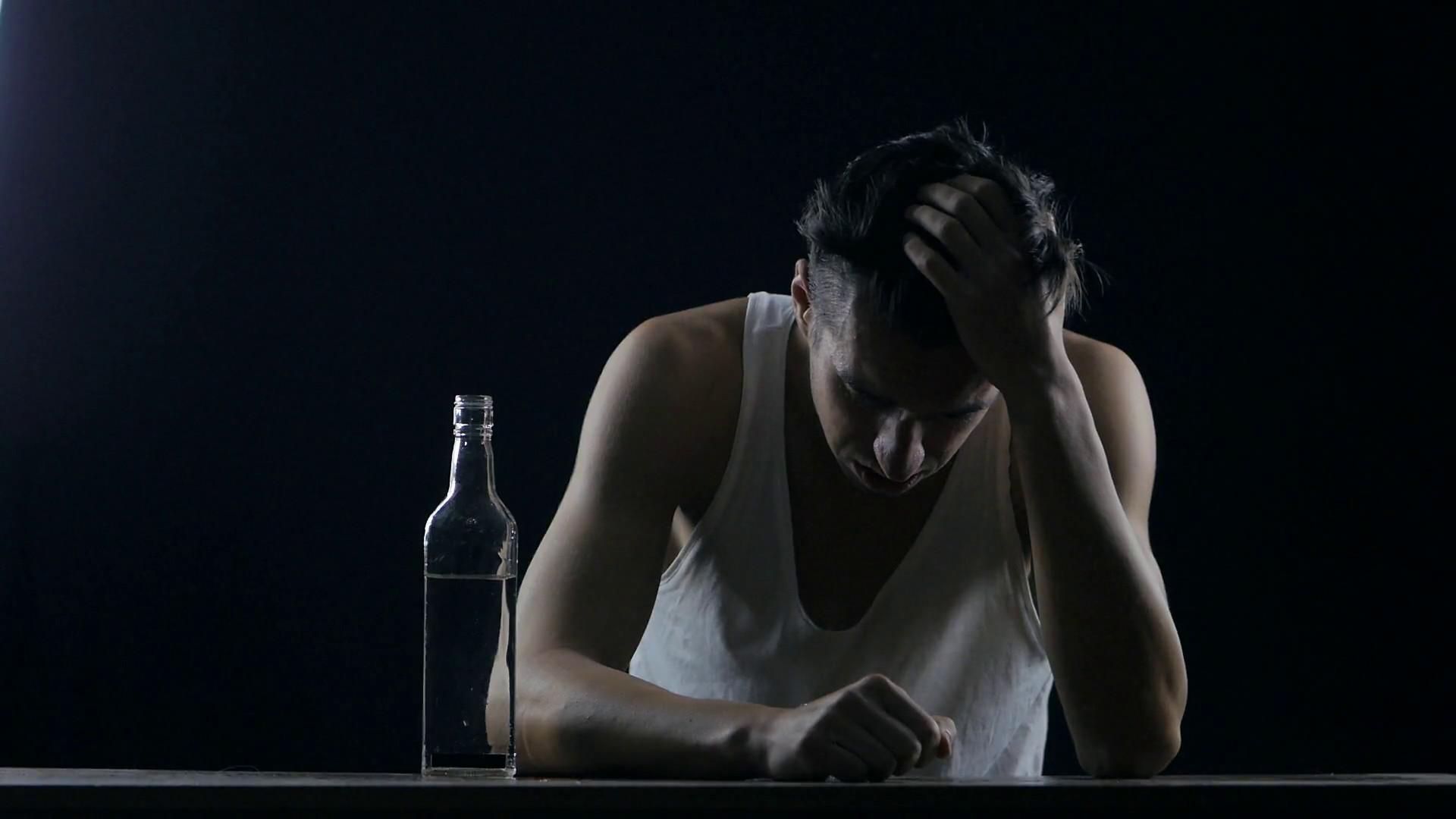 depressed man drinking alcohol alone in a dark room. man in despair Stock  Video Footage – VideoBlocks