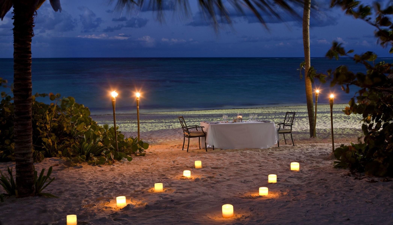 romantic beach night night beach dinner candles ocean romance sunset