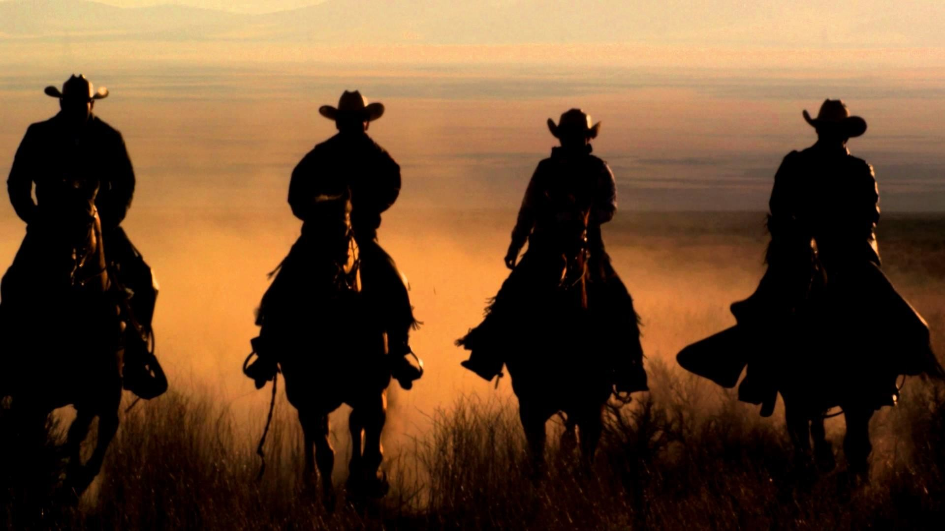 Slow-Motion-Panning-Shot-Of-Four-Cowboys-Riding-